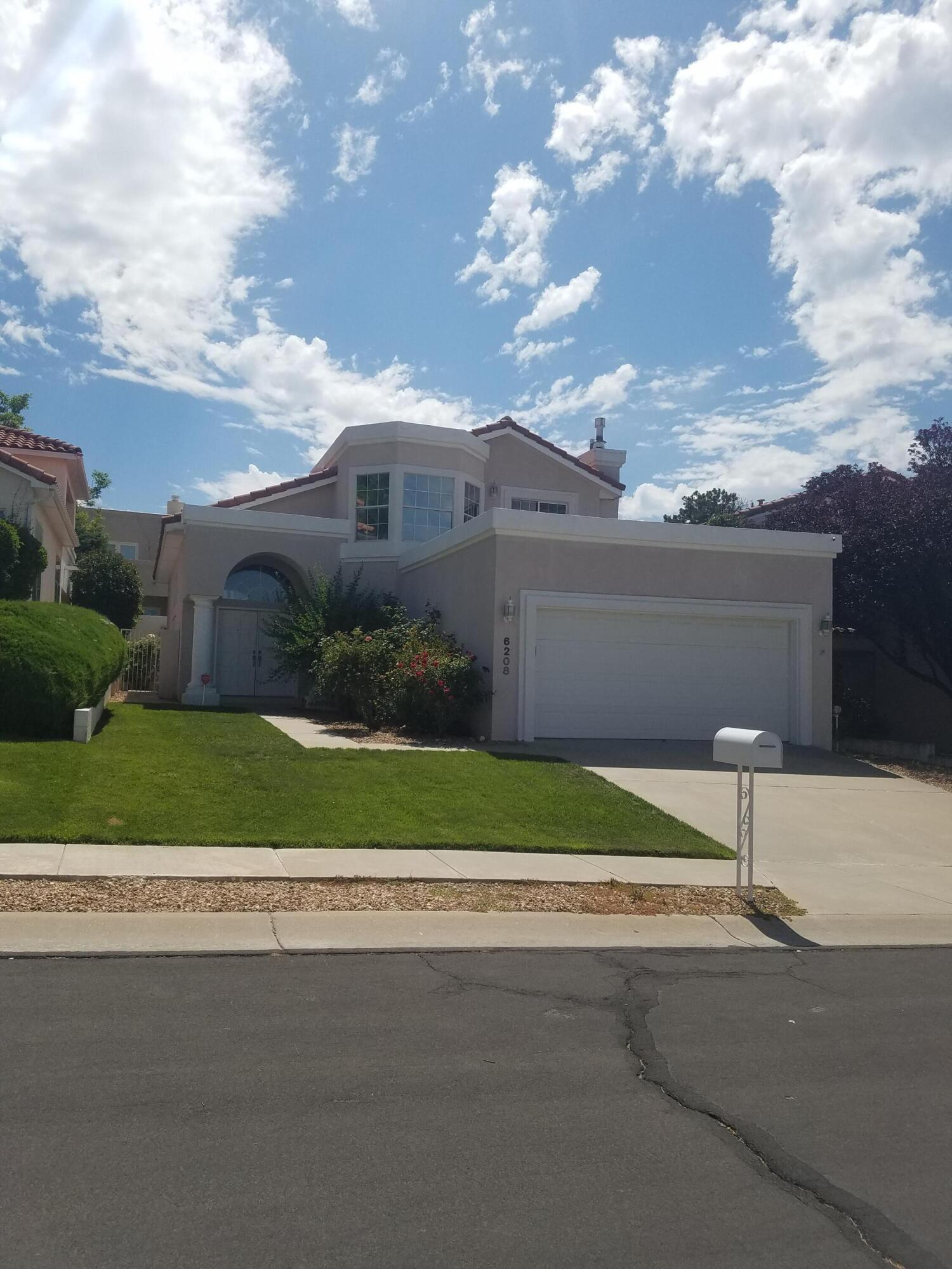 Remodeled and back on the market.  Charming floorplan with  soaring ceilings in great room and dining room.  Wood floors and some carpet upstairs.  Freshly painted,  Remodeled kitchen, new granite countertops, sinks, fixtures, tile surrounds, and appliances.  Upper deck has dramatic views of the beautiful sunsets.  Location! Location!