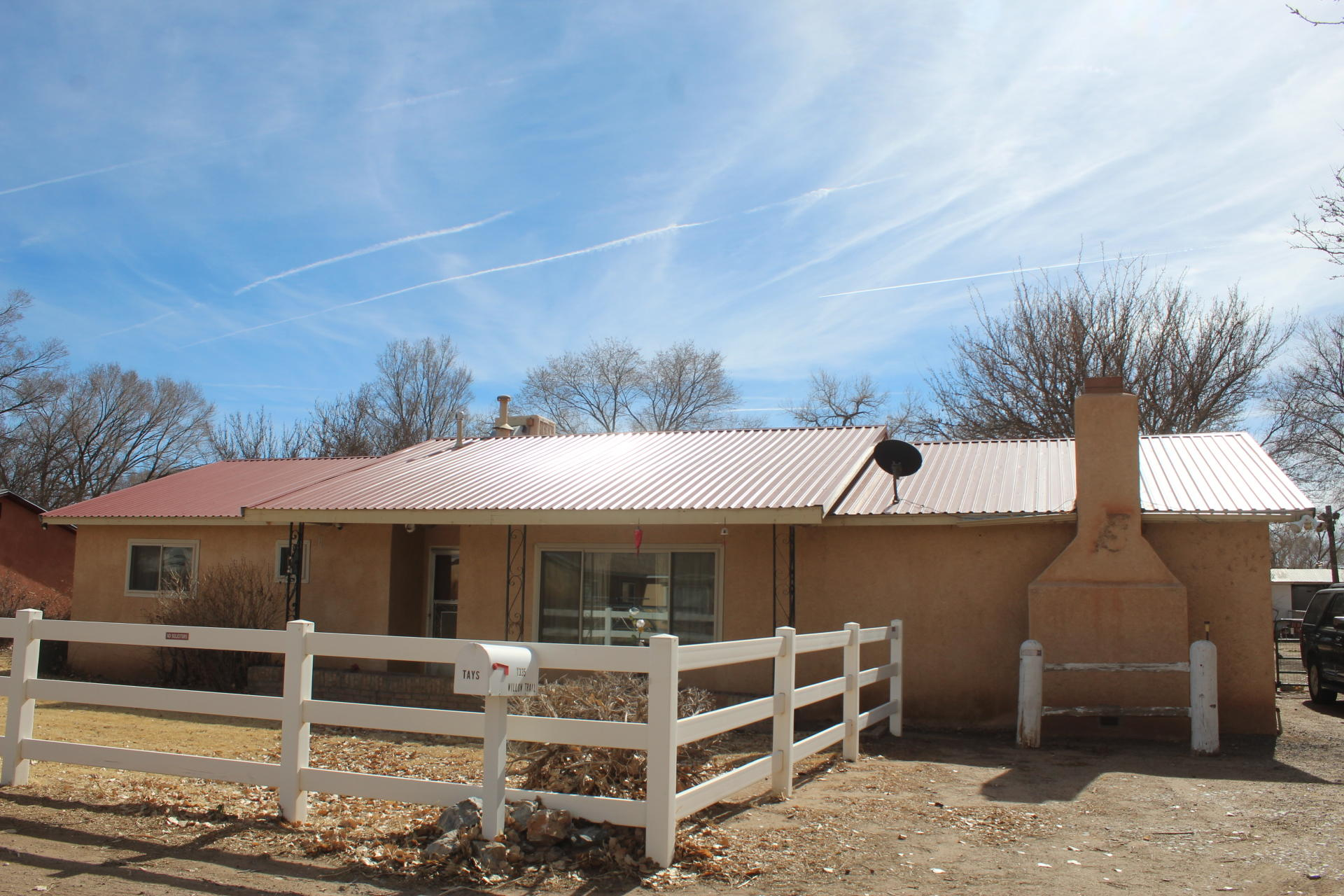 Nestled in quiet neighborhood in the heart of Bosque Farms. Loaded with potential this great family home has 3 bedroom plus an office, den with fireplace. several out building for storage & workshop, RV clean out.There is additional acreage for sale call for details.