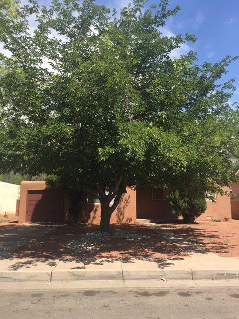 Won't last long! This charming home is in a great location, with easy bus and bike routes to both Kirtland and UNM. Inside you will find red oak hardwood floors, a spacious kitchen, formal dining room, and plenty of living space for entertainment. Covered patio with built-in speakers looks out over a spacious xeriscaped backyard and is a perfect spot for entertaining guests or just a little rest and relaxation. Come and see this beauty today!