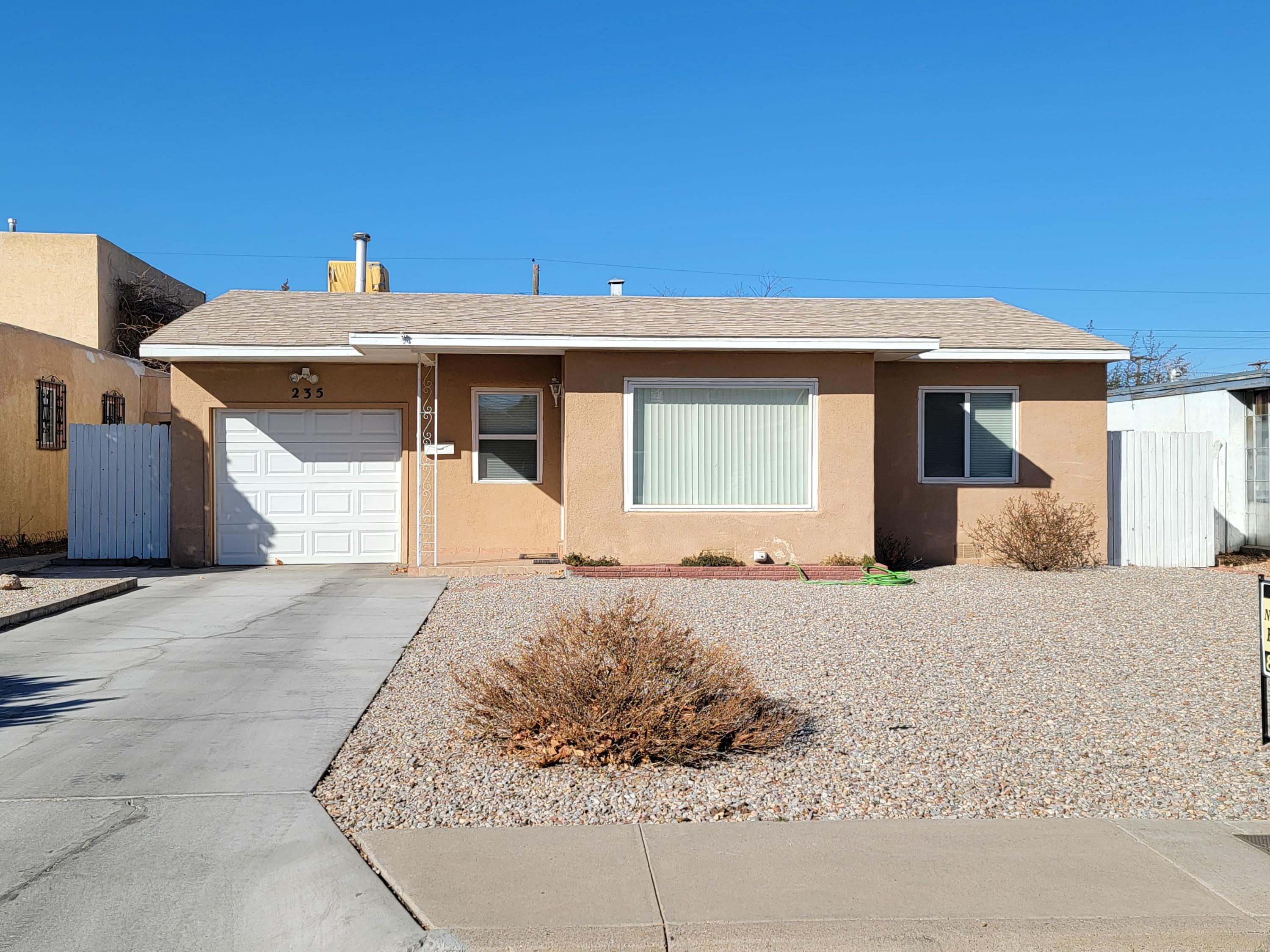 Price Reduced!  UNM .... 2 Living areas, 2/br, 1/ba, 3 car garage (1 attached - 2 detached).  Original hardwood floors, updated kitchen, bath and windows.   All appliances stay.  Covered patio outback.  Backyard access through alley (w/electronic gate) into detached garage w/workshop.  Additional storage shed.