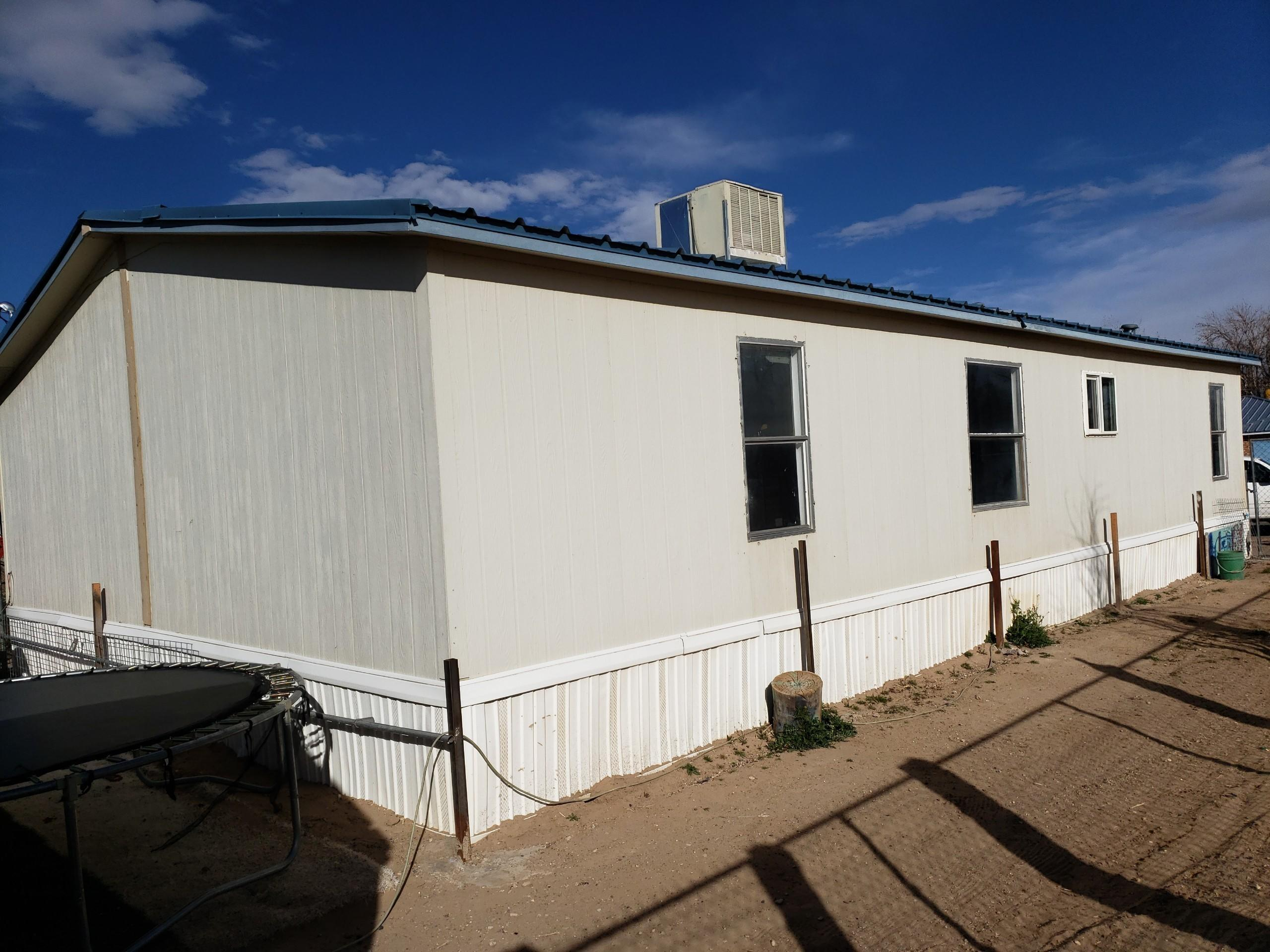 Come and look at this manufactured home. it is on a permanent foundation fenced yard newer carpet and flooring.