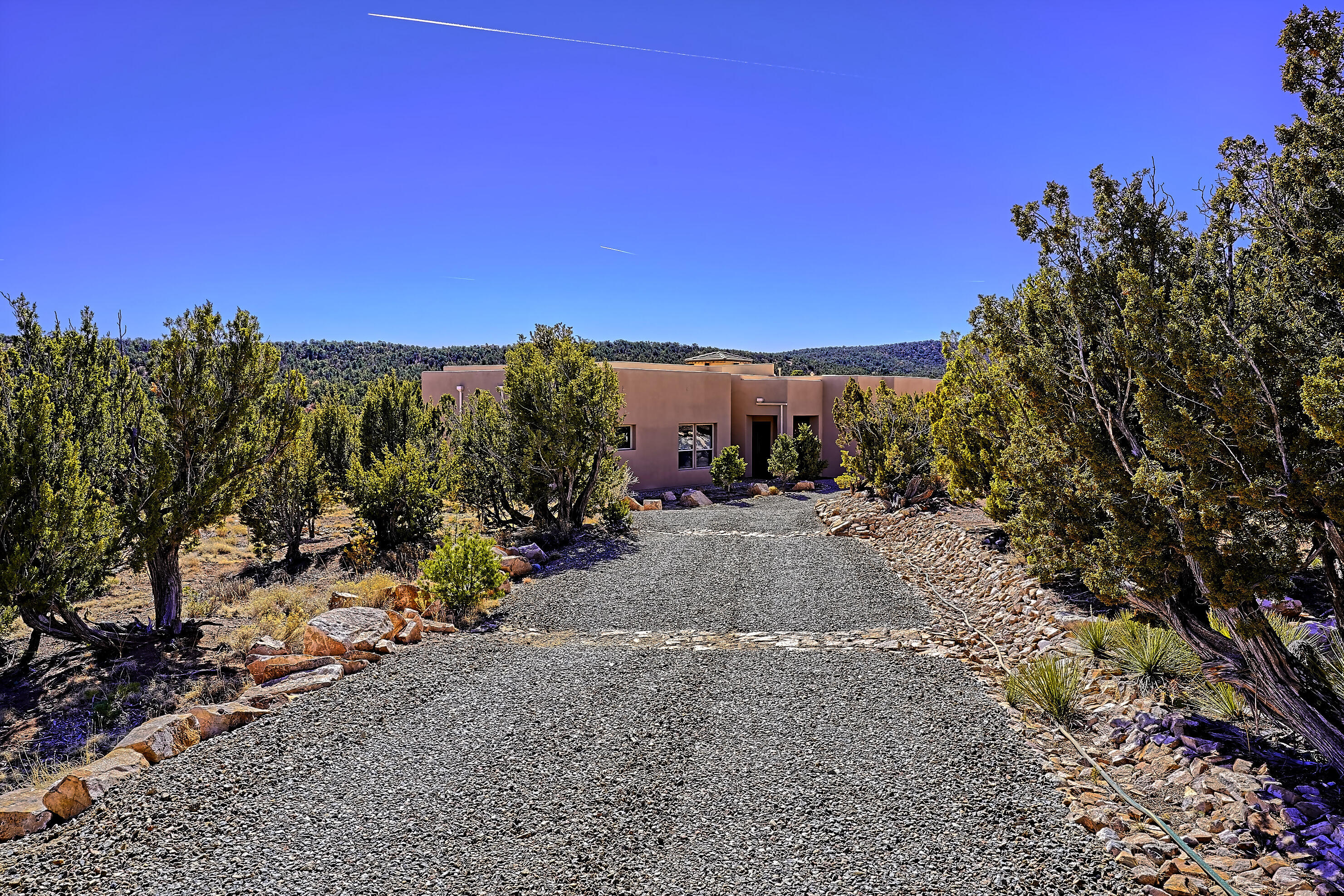 Stunning Panorama Pueblo Style Home Nestled Next to the Paa Ko  Ridge Golf Course! From the Beautiful Foyer You will enter into the welcoming great Room with its stone stacked fireplace, effortlessly opens into the Gourmet Kitchen with High End Stainless Appliances, Huge Island, Gorgeous Granite, Roomy Pantry along with Well-Designed Living Spaces Displaying Elegance and Quality throughout. Incredible Covered Patio Complete with Outdoor Kitchen Grill and Prep Sink Overlooking the Finish of Hole #1.  Master Bathroom Boasts Double Sinks, Jetted tub and Awesome Snail Shower.  Oversized Three Car Garage has a Finished storage room. Brand new TPO Roof. Private gated Area in Fabulous Paa-Ko with Natural gas & Community Water along with the Club House, Pool, Tennis, Golf and Remodeled Restaura