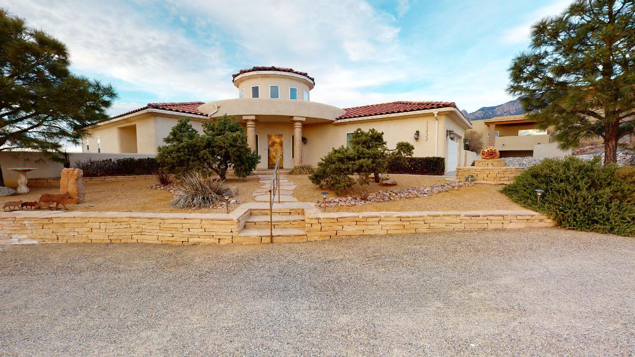 Large custom southwest/tuscany home on almost an acre with wide open panoramic views on low traffic one outlet street. In the County but close to all conveniences in town. Has 2- two car garages plus 1 car or workshop. Lots of hammered/fired copper accents. Bancos on fireplaces. Laundry area upstairs and downstairs. Could be multi-genarational arrangement for elder parents. High effeciency heating system and both refrigerated and evaporative cooling.