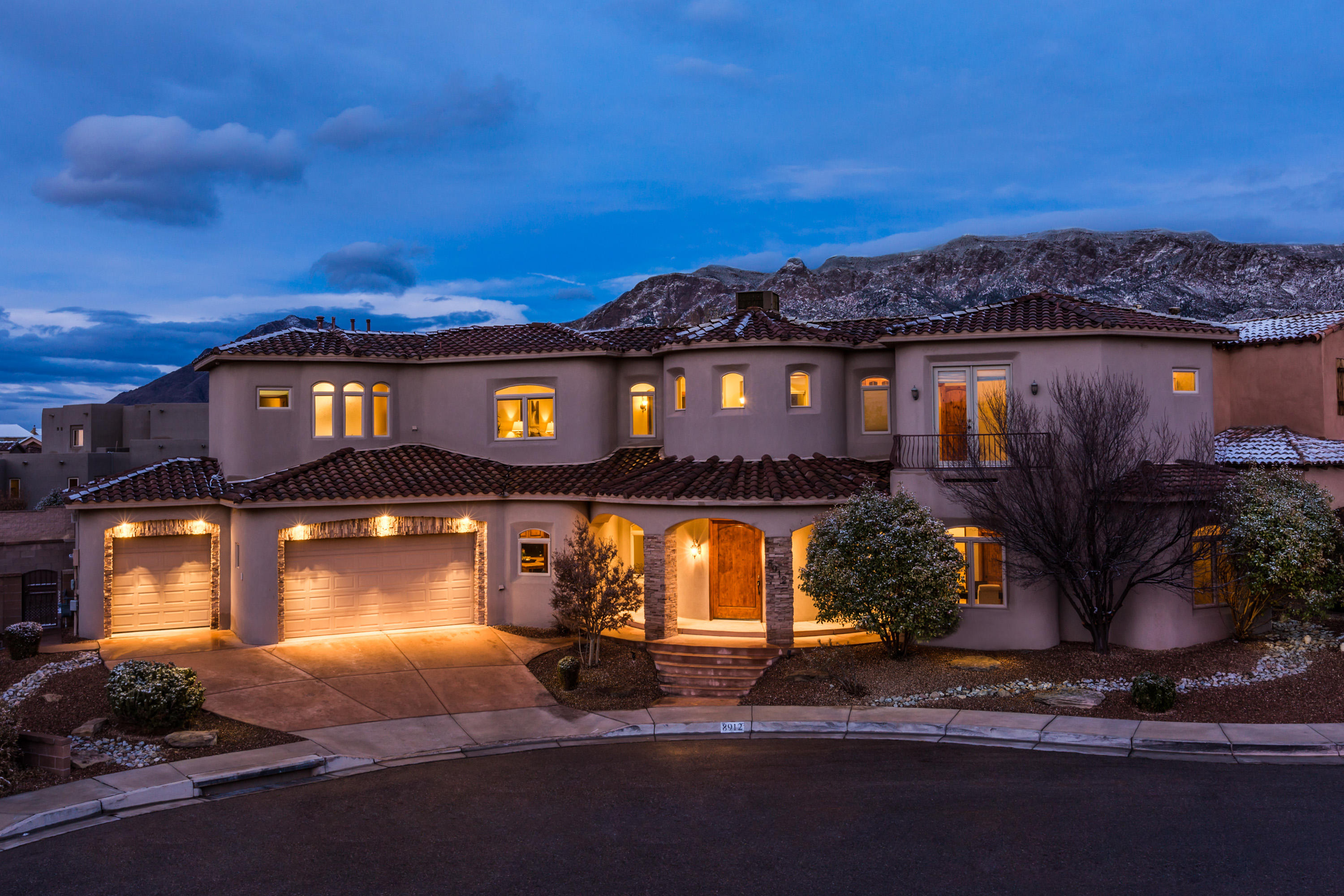 Amazing Sandia Mountain views from this elegant Renaissance Builders 2 story! Quite cul-de-sac, only 2 blocks form La Cueva High School. 5 bedroom, 4 bath stunner with gorgeous Calderwood cabinets and solid wood doors. Kitchen is open to formal dining and living room with soaring ceilings, cozy fireplace and lots of natural light! 2 bedrooms, 2 baths on main level. Luxurious curved staircase leads to the owner's suite, boasting double doors, sitting area, amazing bath and best of all, a view deck to die for! An office workstation, 2 more bedrooms and a jack-n-jill bath round out the 2nd level. Backyard is private with huge covered patio, synthetic turf and more space than you would first imagine.
