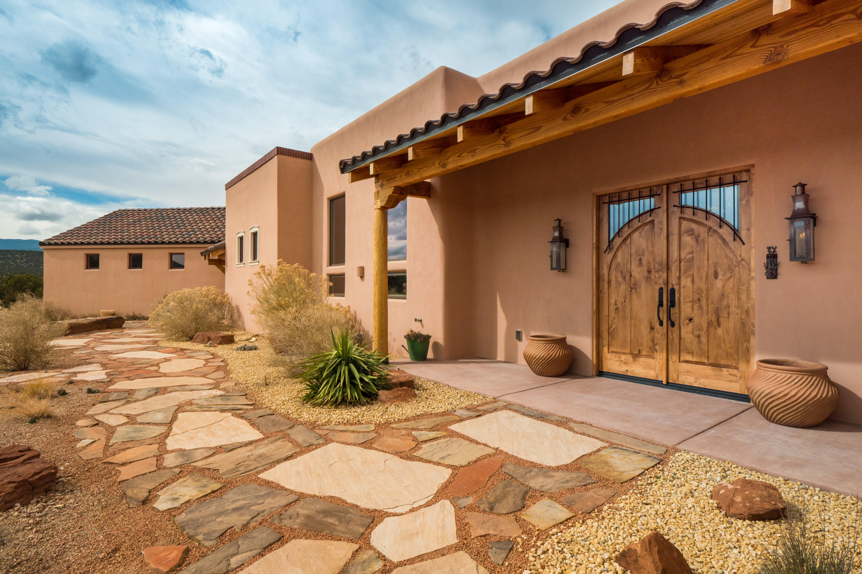 Welcome to this one-of-a-kind, newly constructed (2019) home located in the desirable, gated community of San Pedro Overlook. Featured in SuCasa magazine, this home was designed with a true ''hacienda'' in mind with the exterior accessible through nearly every room. The ensuite is a delight, with a HIS/HERS master with separate bedrooms, bathrooms & closets. The owner spared no expense in creating this luxurious getaway including: 2x6 construction, Semco windows & doors, Italian tile floors, custom doors & vanities from India, 1760's cast iron gates from Scotland, extensive landscaping & MORE. With high efficiency mechanical systems, this home is affordable to maintain. Community amenities include a workout room, pool, walking paths, trails. Situated on 4+ acres with breathtaking views.
