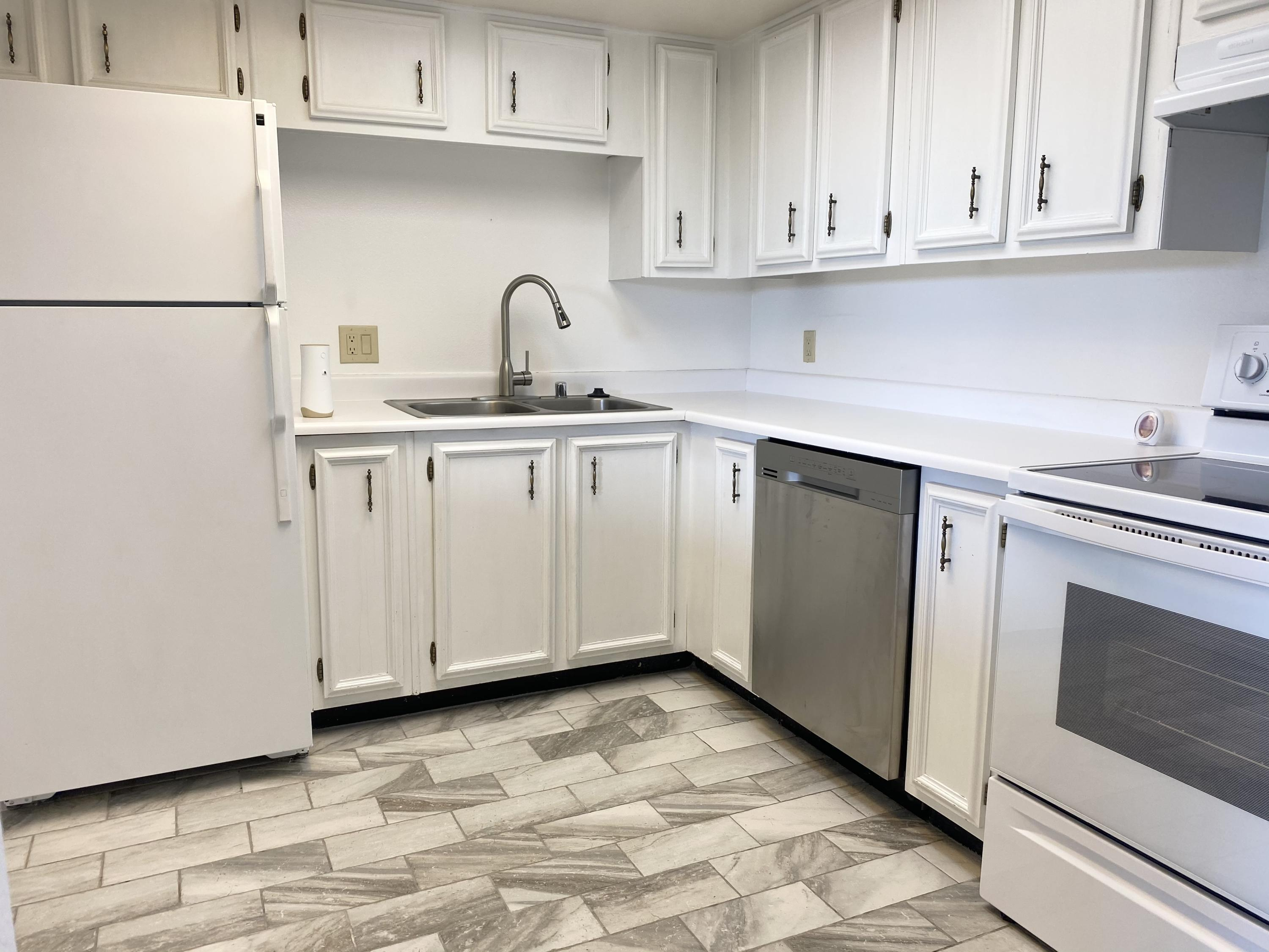 Super cute condo in the heart of Rio Rancho, located near shopping and access to all the main roads.  Come view this 2 bedroom well maintained condo.  Bright and white the kitchen is open to the dining and living areas opening up the living space to the back closed in patio.  Newly built fence offers privacy in the patio area but opens to a small bricked patio extension and grass shared yard.  This complex offers a community pool and an HOA that covers the exterior of the residence and some utilities.  Refrigerated air and washer and dryer in the unit these do not last long.