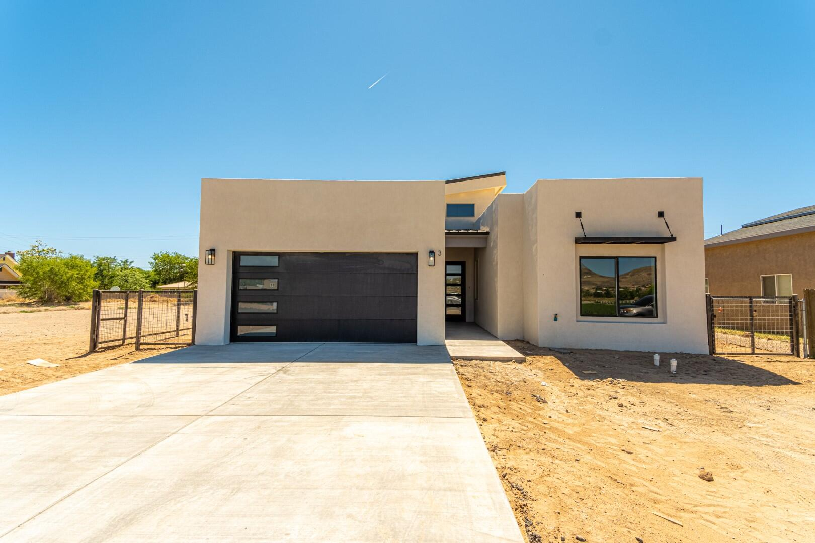 Beautiful new contemporary custom home in great location.  Open light & bright floor plan w/2,172 sq, ft, 3 bedroom, 2.5 baths. Enter this home under covered porch and open the door to the impressive vaulted Entry Tower welcoming you to the main living area w/impressive vaulted ceilings & a gas-log fireplace.  The gourmet kitchen is at the heart of the home  with a walk-in pantry, large island w/plenty of guest seating at the breakfast bar.  The living space is perfect for entertaining and is open to the family room & large dining room.  The outdoors joins indoors as living area opens to an atrium and covered patio. Master Suite is luxurious w/huge walk-in closet & spa bath w/double-sink vanity & separate walk-in shower & garden tub.  Refrigerated air. All City utilities. Not in flood zone