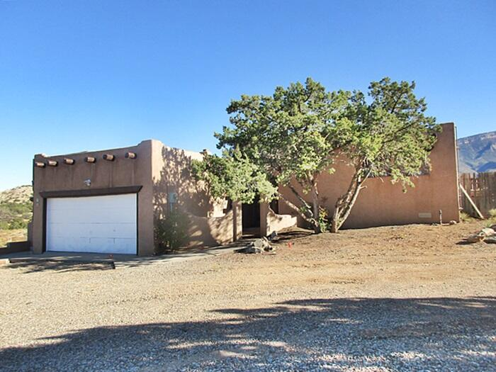2 story home,recently painted and new carpet on over 4 acres  in  Placitas Homesteads with views of the Sandias with the Jemez or Capulin Peak to the west Access to shopping, dining and more. Less than 3 miles from I25.  Natural gas connection in progress. Electric is on, water is off waiting for gas meter.