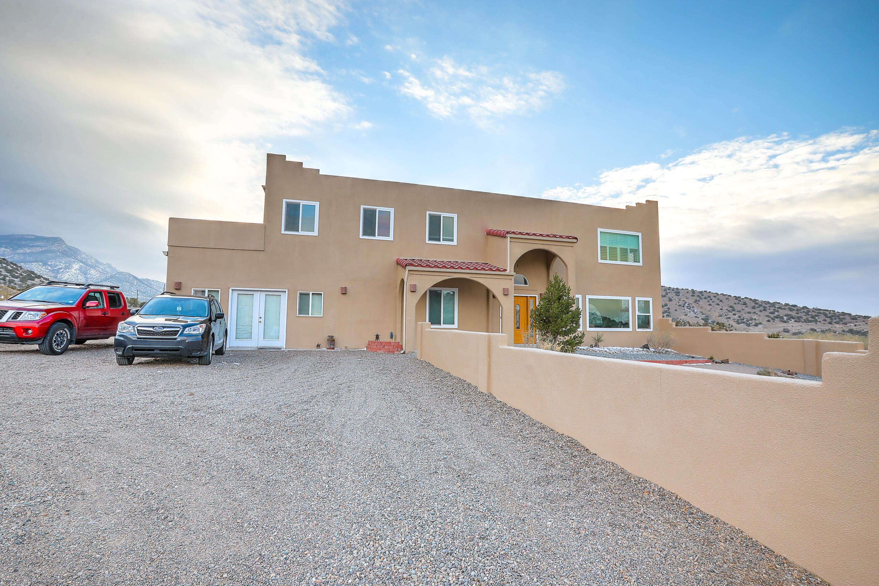 Spectacular 3,500sf contemporary home with endless views in all directions. Recently upgraded to refrigerated air! 4 Bedroom plus a dedicated office space. 3 updated bathrooms! Situated atop 1.6 beautiful Placitas acres. Turn the the corner to breath-taking views in every room. Come see this unique and spacious home before its gone.