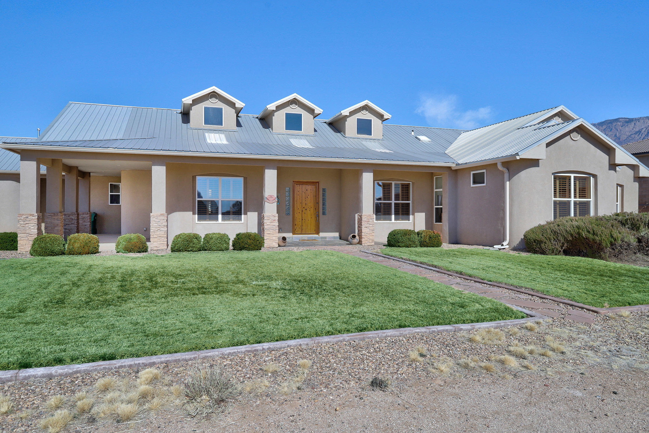 Come check out this beautiful custom home in Albuquerque Acres! Home features include Gourmet Kitchen, Granite, Custom Cabinets, Stainless Steel Appliances W/ Double Oven, Skip Trowel Plaster, Plantation Shutters, Solid Wood Doors, Recirculating Hot Water, 2 Large Living Areas, Private Master Suite with large  Secondary Bedrooms, and  Office Refrigerated Air and Radiant Heat.