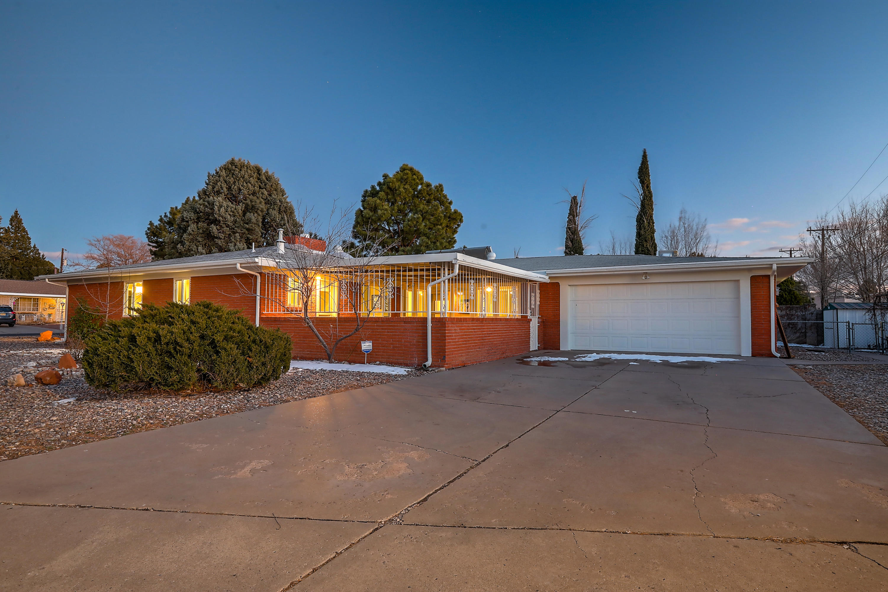 The fabulously updated house in UNM that you have been waiting for! From the gleaming hardwood floors to all of the shiny countertops and appliances this home sings! All appliances are new including the washer and dryer. Lighting is all LED, including the recessed lighting that has been added. The windows have been replaced and are easy-clean tilt-in. The fireplace has a gas insert and can also be woodburning. Who ever heard of marble window sills? Here they are! The bathrooms are also completely redone. Enjoy the wonderful New Mexico weather from the enclosed patio.Great location near shopping, UNM and all of its activities, Interstates, Nob Hill and its restaurants. Perfect in every way.Complete with new plumbing valves and water meter.