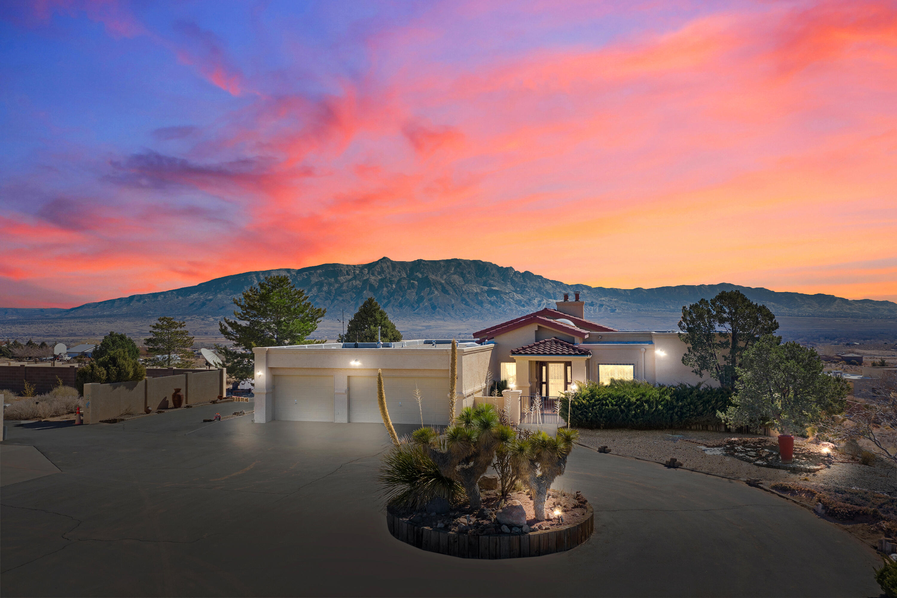 Looking for views? This custom home has unmatched views of the Sandia's, come see for yourself. The heated pool, plus in ground spa, outdoor kitchen and cozy fireplace provide a backyard oasis. Yard includes a basketball court!The house really features the spectacular views with all windows and walk outs facing East. Gorgeous updated details in the kitchen and baths. The downstairs has an additional 3 bedrooms, recroom, kitchen, living room, and dining room! The 40'x75' shop is covered indoor parking for your RV, Loft for storage, plus bathroom! RV hook up and dump. Sale includes an additional 1 acre home site.