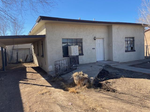 Affordable home in a convenient Belen location!  Interior just painted, new carpet and vinyl.  The lot is big enough for an addition.  Detached garage and back yard access.