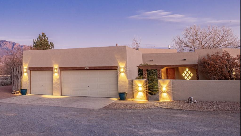 Beautiful 4 bedroom Southwestern custom home conveniently located in Corrales with amazing views on a quiet cul-de-sac. Featuring a spacious great room with raised beams, carved vigas and an abundance of natural light. A large backyard with a gorgeous custom pergola and a covered porch. Oversized three car finished garage. Separated master quarters with a private spa like master bath with double vanities, jetted tub, large double head walk-in shower and large walk in closet. Fully OWNED SOLAR ELECTRIC panels with transferable warranty, New LED lighting throughout, hot water radiant floor heating with 8 zones, water softener, and instant hot water recycling system, new gas cook top, new carpet through out, fresh paint, back yard and RV access drive area, new septic system recently installed
