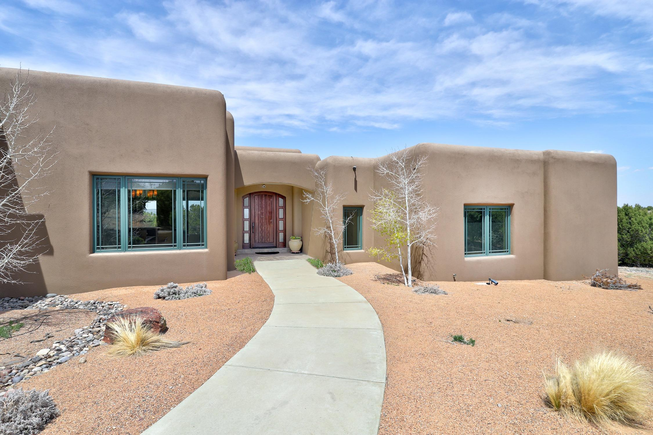 Spacious custom Crombie home on 3+ acres in the desirable Sandia Park neighborhood of San Pedro Overlook. Luxury amenities from start to finish! Modern kitchen with Kitchenaid Superba appliances, 6 burner gas stove and wooden hood, double ovens, bill paying center with remote computer, Halbert cabinets, granite counter tops and large pantry. Formal dining room with gas fireplace, hanging ceiling and indirect lighting. Gracious master with ensuite includes a soaking tub with surrounding views of the Sandia mountains. Pella architect series windows and electric Hunter Douglas window coverings. Theatre room with 92'' Stewart Filmscreen and Runco 720P projector. 7.1 marantz Surround Sound, Theater seating & indirect lighting.