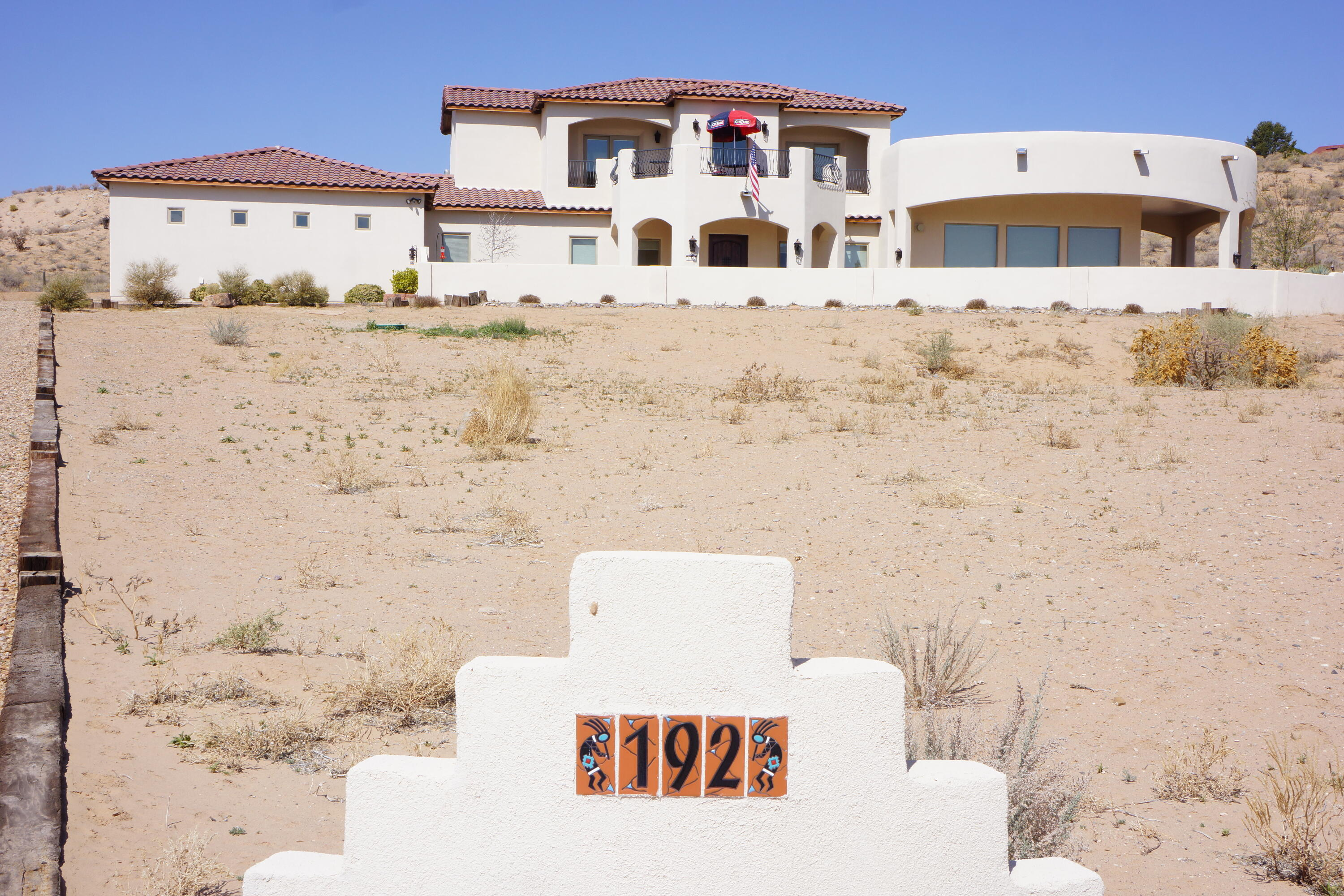 Views! Forever unobstructed views of mts., north valley, bosque, balloon fiesta, etc. from this Corrales home. This 3460 square foot custom built home is on .97 acres and has three bedrooms, 3 1/2 baths, an upstairs Study/Library with wet bar. The flex room near the Master BR currently used as a gym would make a great nursery with plenty of natural light and access to the back yard. Completely landscaped walled-in front and rear yards. Oversized 3 car garage with attached workshop. Enjoy the central air and radiant heat throughout. Pella windows and exterior doors. Custom Alder cabinets and SS Jenn-Air appliances including a built in refrigerator. Large laundry room with custom cabinets and room for a second refrigerator. Gas fireplace for cold evenings. A rare find that won't last long.