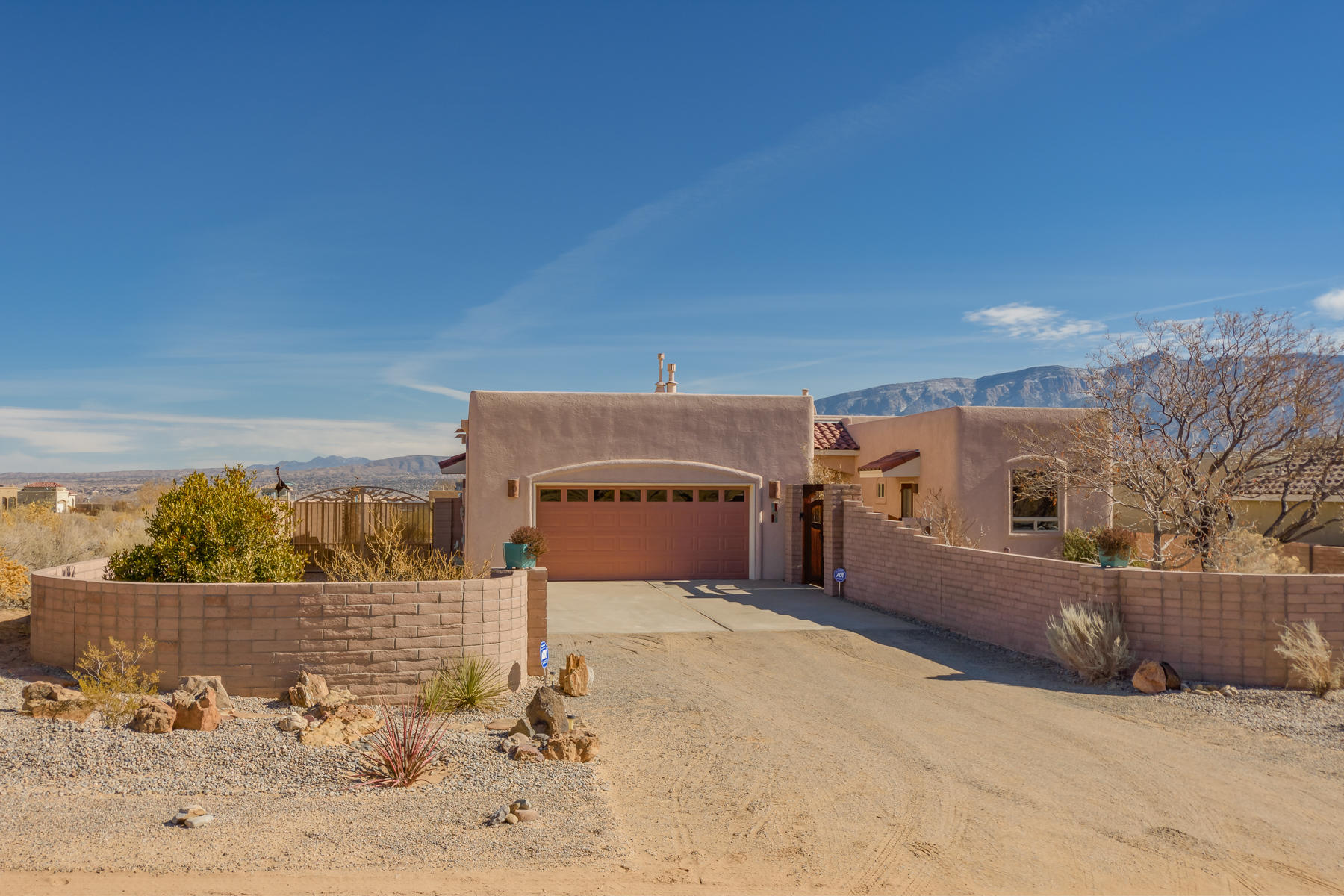 Custom Hinkle Home w/ Million $$ views  from SF to Los Lunas.  Main home is  2000 sf, 3 bd/2 ba. The attached casita adds 300 sqft: Guest Qtrs or office w/ closet & 3/4 bath. Home has been beautifully updated w/ Quartz kitchen counters &  wood Floors.  Owners added kitchen bay window(with copper roof line) & replaced  DR windows & slider(Anderson brand) Gorgeous custom portal & xeriscaped backyard. Property perimeter is walled using slump stone brick for an adobe look. Kingsized Master suite & 2 guest rooms w/ wood floors. Nicely appointed w/ natural wood doors, nichos &  shutters throughout.  Front yard is enclosed in courtyard & there is side yard access to the north.  220 outlet/30amp for charging an RV too! So much to see &  appreciate!Make appt. to visit this spectacular home today!