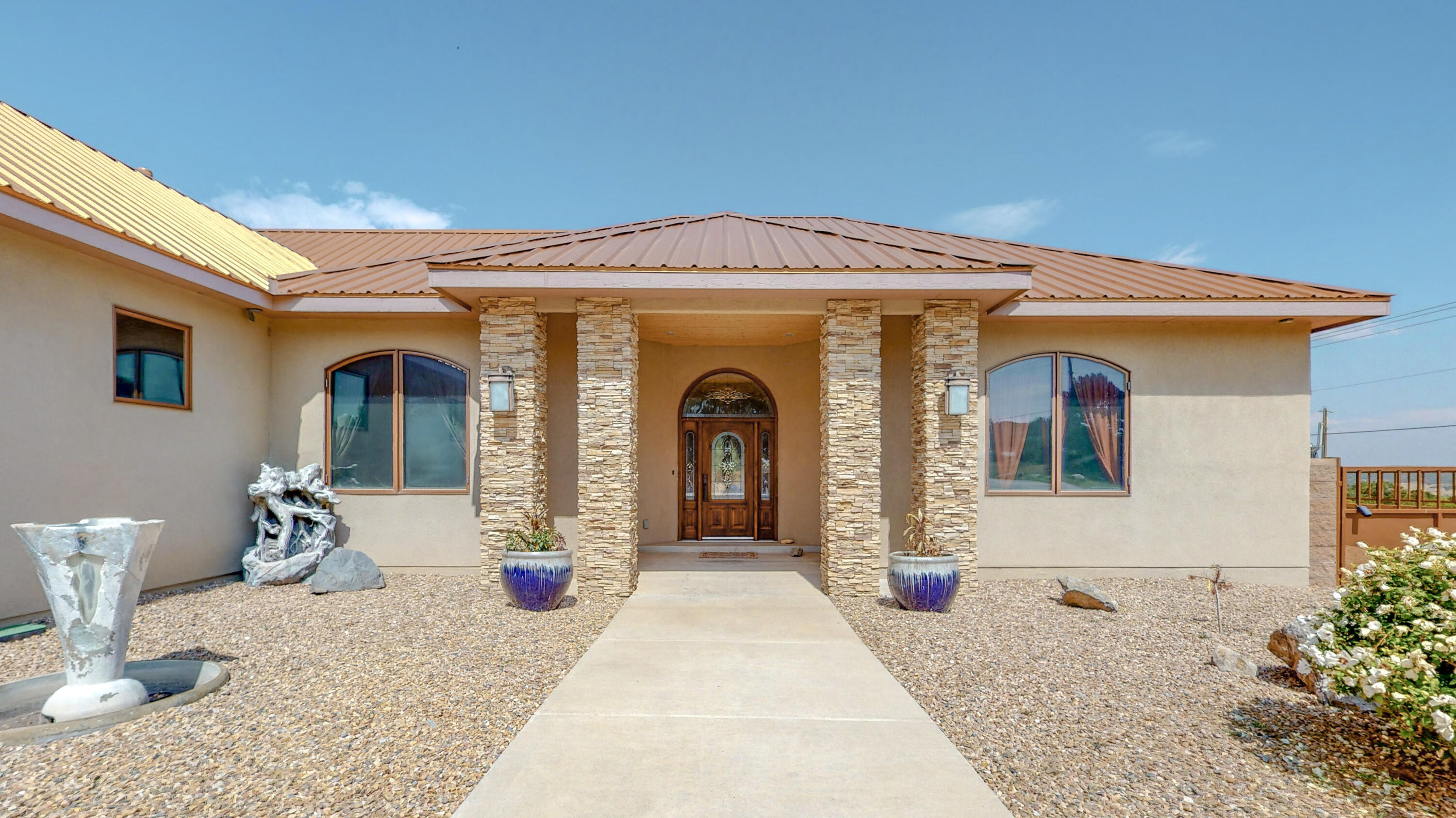 Beautiful custom home on 2 acres of land located in Sandia Mountain Ranch a private mountain community. Builder/Owner has spared no attention to detail! This luxury gem offers soaring 11' ceilings, knotty alder doors and cabinetry, travertine walls in kitchen & baths, granite countertops, water softener system, gourmet kitchen with induction kitchen cooktop, built in refrigerator, double oven and bread warmer! Refrigerated A/C, covered outdoor patio with built in BBQ grill, RV pad and insulated finished garage with epoxy flooring. Water, propane and electricity located behind the home is readily available for future addition. Easy access to I-40 and is approximately 20 minutes from ABQ, Kirtland Air Force Base. Close distance to shopping, restaurants and malls.
