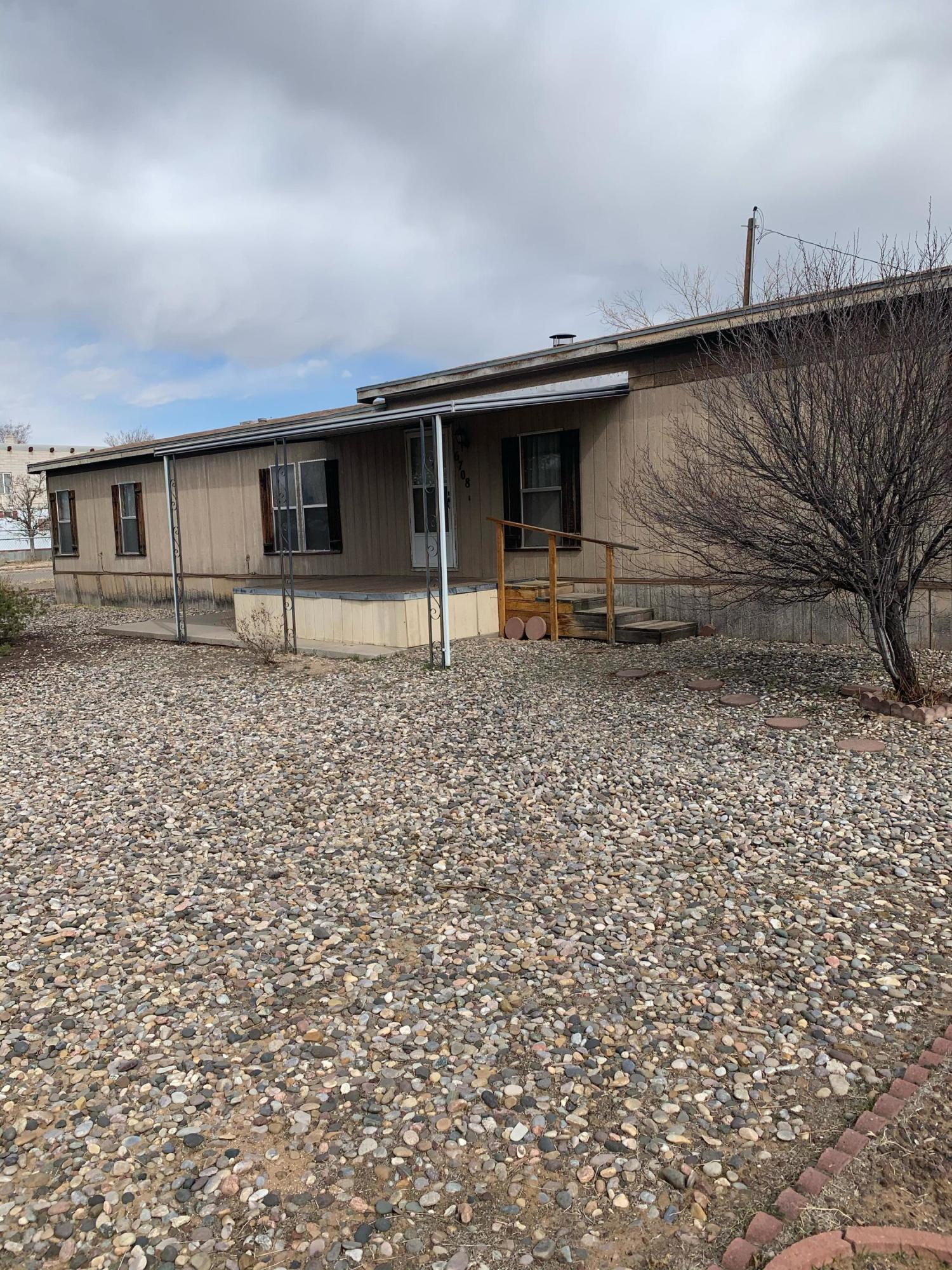 North Valley setting on 1/2 acre. Fenced yard, newer heating and refrigerated air. Property needs some work but an excellent opportunity. Please do not use back door or go onto back porch. The porch is not very sturdy.  Tankless H/W heater.