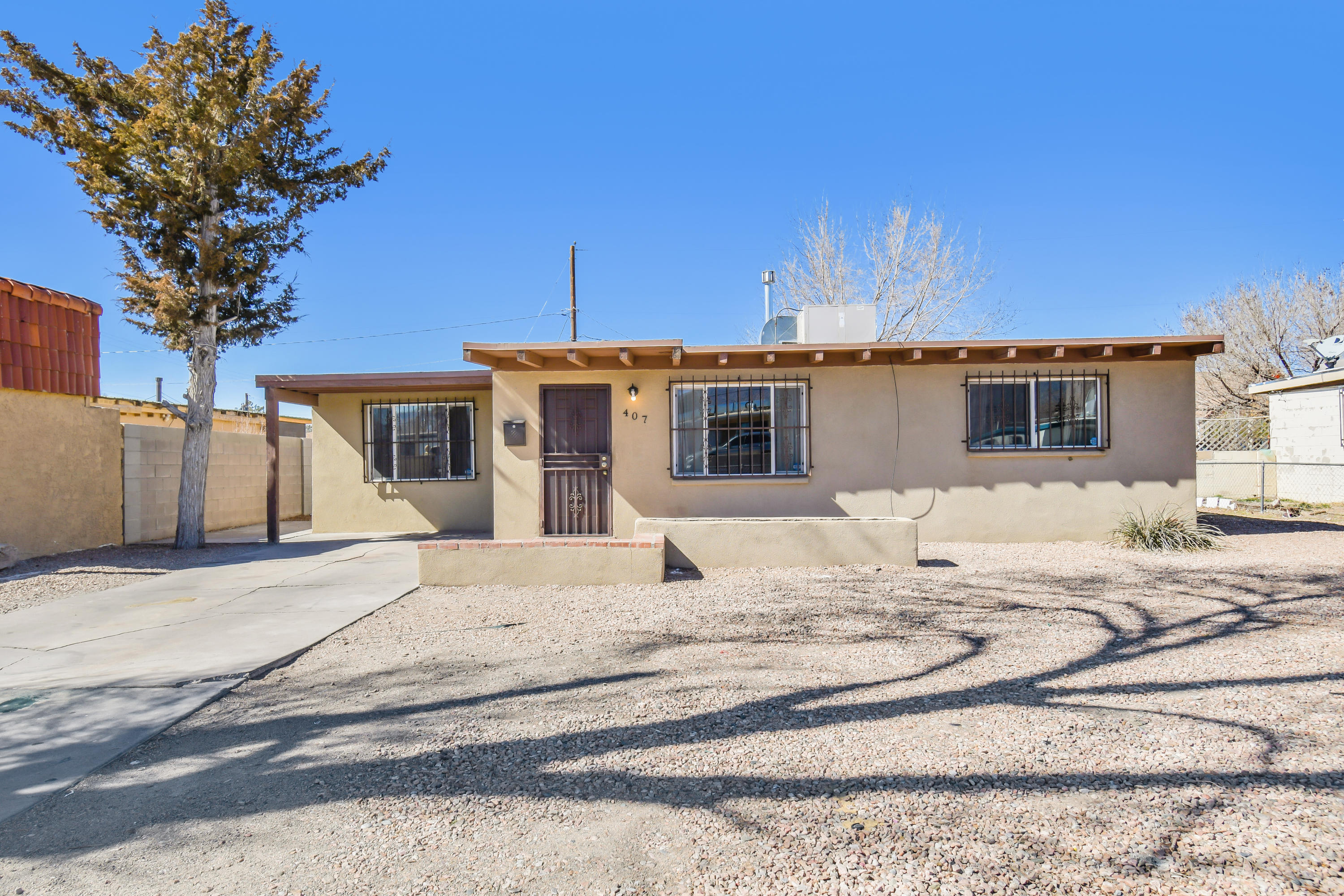 This 3 bedroom home features wood beamed ceilings and newer tile and vinyl flooring throughout. New master cool unit and security wrought iron has been added to windows.Huge backyard w/ two storage sheds. Furnace recently serviced.This rare opportunity won't last long!