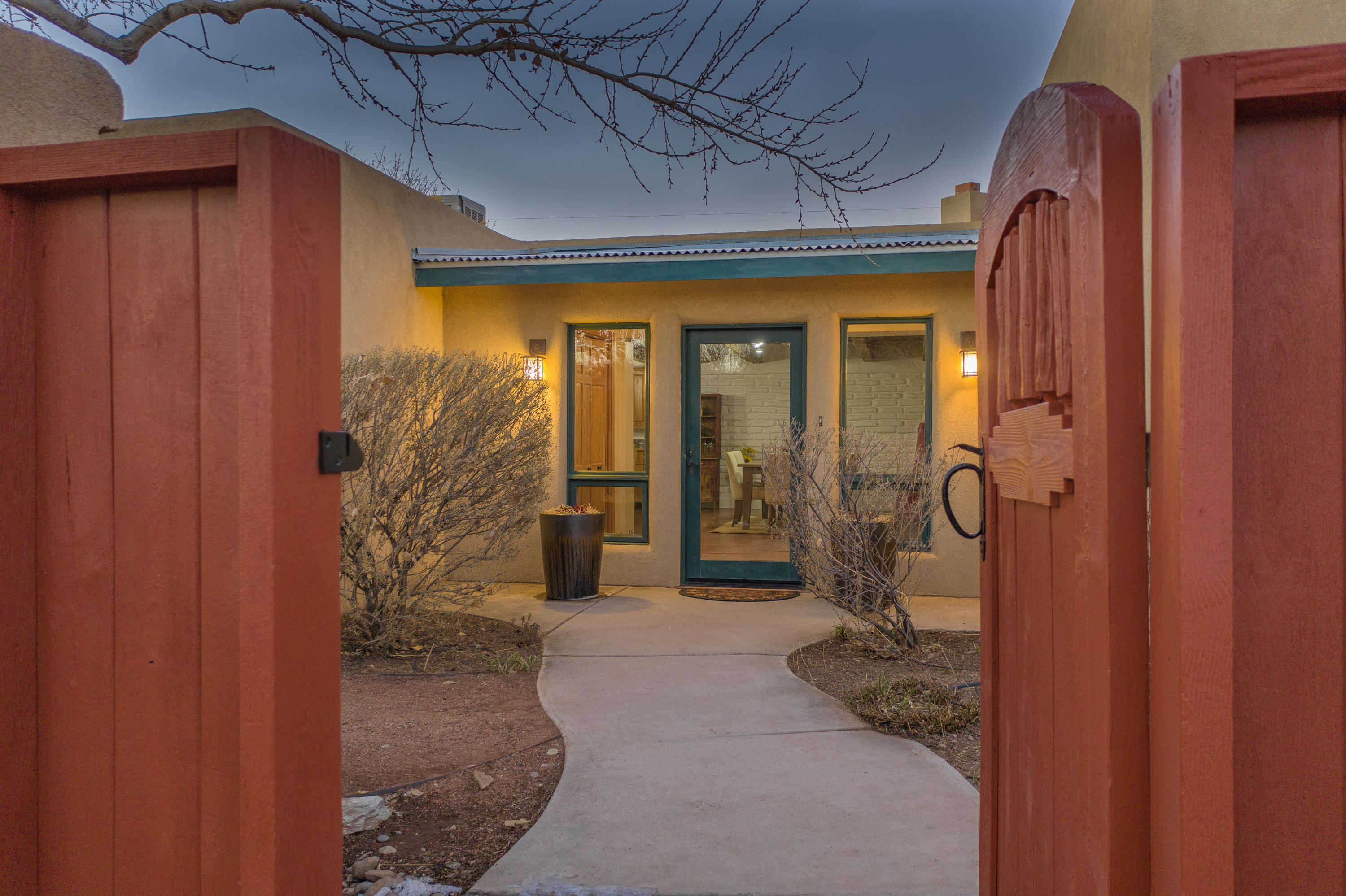 Come home to your piece of Santa Fe Style nestled in the desirable north valley, conveniently located and on a corner lot. This hidden gem has access to the acequia, w/proximity to the Bosque, Nature Center, Rio Grande River & miles of walk & bike paths! Located on the west side of Rio Grande Blvd, in a tranquil, peaceful setting. The home boasts a spacious & open floor plan with 2 large master bedrooms, 2 large baths, w/one large walk-in closet. Possible office space with separate entrance. Amenities include fresh paint, charming brick floors, radiant floor heat, formal dining room & island eating area, cozy up next to the 2 kiva fireplaces, owned solar, RV parking, enjoying your morning coffee on the covered patio and so much to fall in love with! 3DTour: http://bit.ly/2201Gabaldon