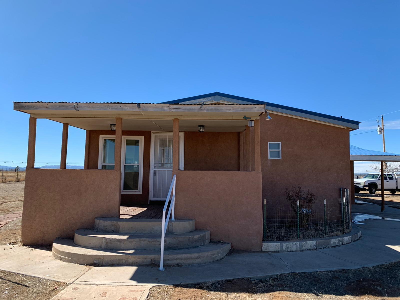 Updated manufactured home on 7 acres!  3 bedroom, 2 bath, 2 car garage,  Two separate living areas.  Full master bath with garden tub and double sink vanities.  Open kitchen, 2 fireplaces.  Fully stuccoed on a permanent foundation.
