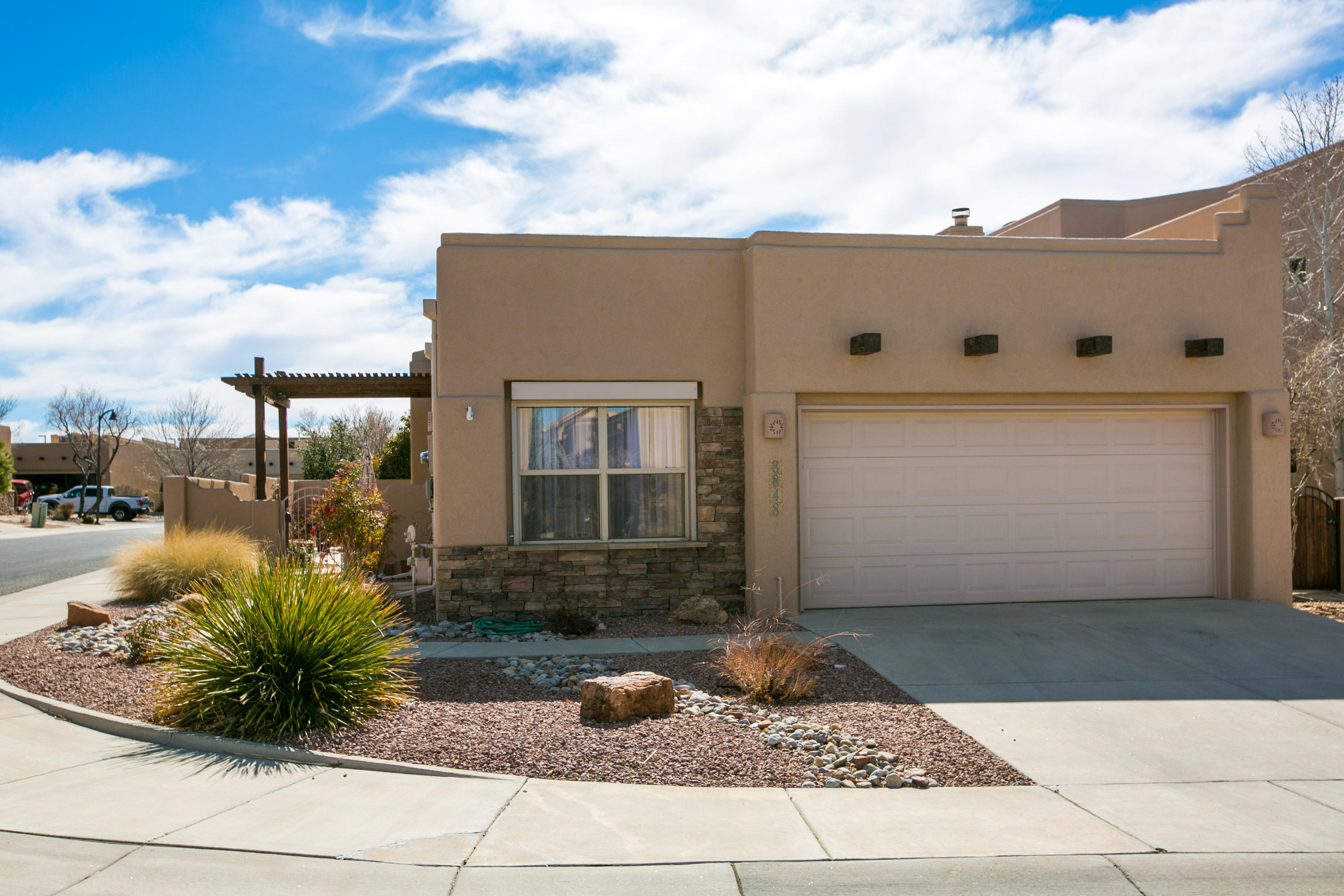 This great single story home is located on a corner lot in the Desert Ridge gated community. This great community is located within walking distance to Albertsons & Trader Joes, multiple local restaurants, and a variety of other services. It is also located in one of Albuquerque's most desirable school districts. The home features a bright and open floor plan with tall ceilings and lots of natural light. The great room is open to the kitchen and dining room, and the master & guest bedroom are on opposite ends of the house for privacy. There is also an office which could be used as a 3rd bedroom. Updates include hardwood floors in the great room, dining room & bedrooms, and new stucco that was completed in the last 2 years. Refrigerated air will keep you cool! Park access from the community