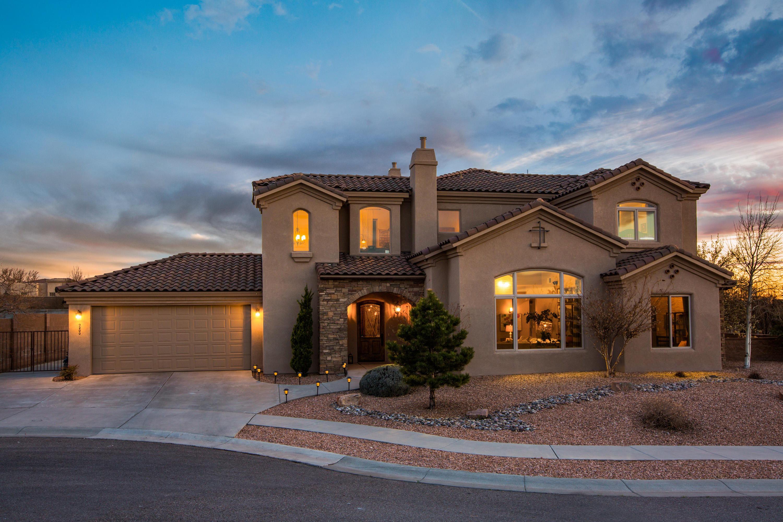 Just Listed!  Spectacular custom NM Gold rated Green home by Keystone. Situated perfectly on a corner lot with city and mountain views.  Outstanding attention to detail and craftsmanship are evident in this meticulously well cared for home.  Casual yet elegant style describes this fantastic floor plan. This beauty boast soaring ceilings that compliment the open and bright spaces.  Enjoy the gorgeous chefs  kitchen w/ stainless Thermador appliances,  polished granite island and beautiful alder wood cabinets. New Dutch wood floors throughout, travertine tile, surround sound w/ IOS apple interface. Simply awesome master retreat includes  2-way fire-place and walk-in closets. Recently installed new gate, paint and widow coverings! This stunner could not be replicated today at this price!