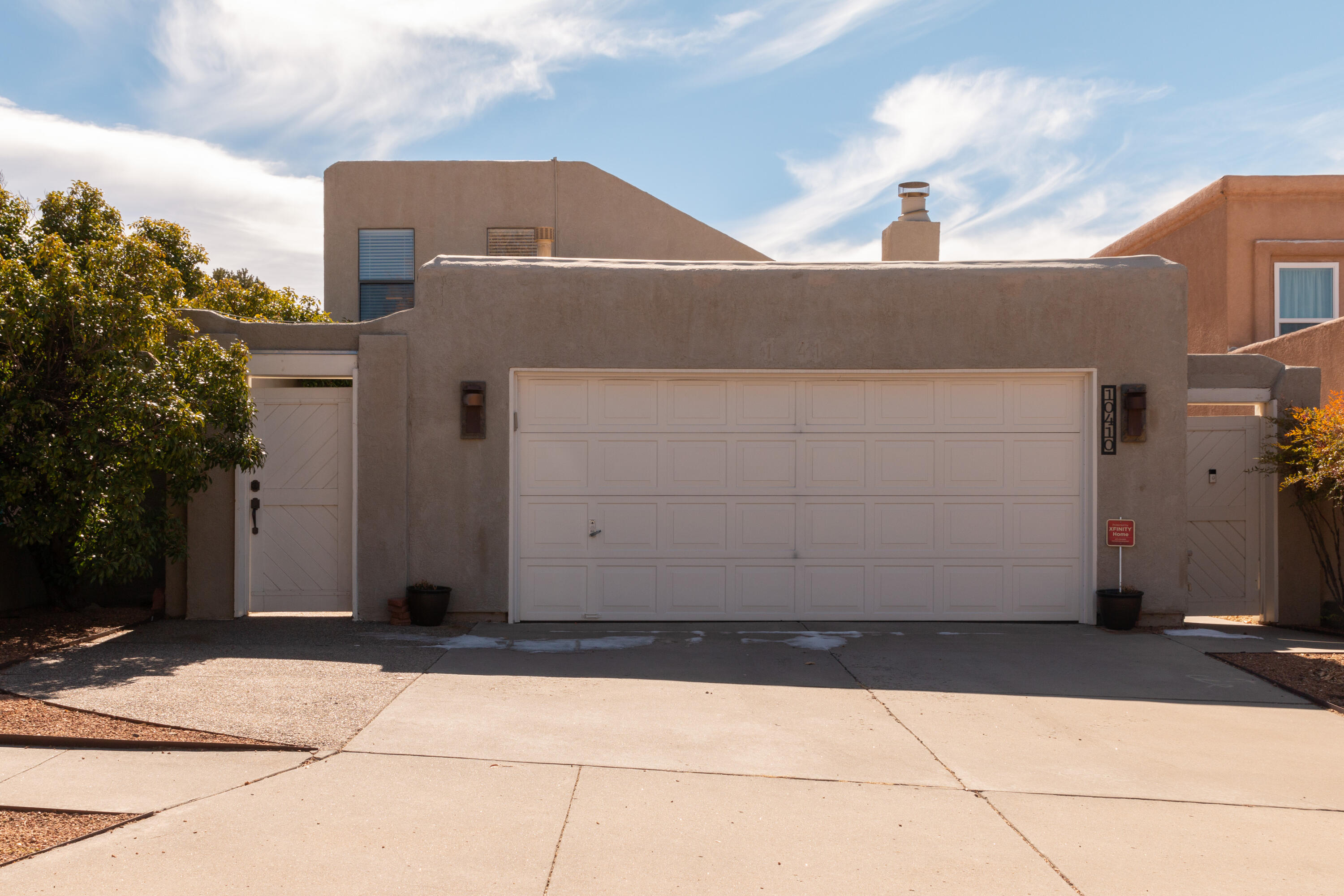 Wow! Step through the private gated courtyard & into this exceptional home. Open living room w/high ceilings, tons of natural light & cozy FP.  The kitchen shows custom cabinets, classy granite tops, stainless appliances & sunny dining area w/bay window. Wonderful guest Bdrm is downstairs w/gorgeous updated bath & a walk-in closet. Bdrm 3 is also downstairs with a private enclosed patio & front drive access. Upstairs shows the elegant Master Suite w/2-walk-in closets & beautiful updated bath. A cozy loft offers a 2nd living area, office or flex space w/some Sandia views. The backyard offers a lovely shaded Pergola, & colorful low maintenance landscape. Such a great place to unwind or entertain. Nice 2 car garage w/painted floors/walls. New TPO Roof 2019! Newer 50-gal H2O. Refrigerated Air!