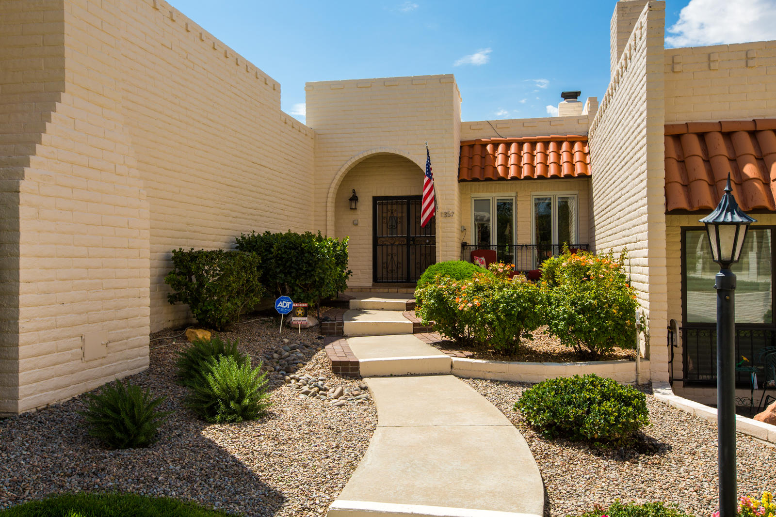 Beautiful Single-Story Townhouse located in Villa Serena Townhomes, a Resort-like community that includes pool, clubhouse & manicured landscape. Villa Serena is in Four Hills Village Area with a Golf course and Country Club! This home has an Amazing Floorplan that includes both Formal Living & Formal Dining with a Kiva Fireplace, Den with Bar, Hard Wood Floors w/ Beam Ceilings, Private Atrium of Second Bedroom, & Private Courtyard. The home has been Newly Painted, the Master Shower has been Redone, New Garage door opener, New water heater. Private Backyard  Courtyard .  A Great Place to Call Home!