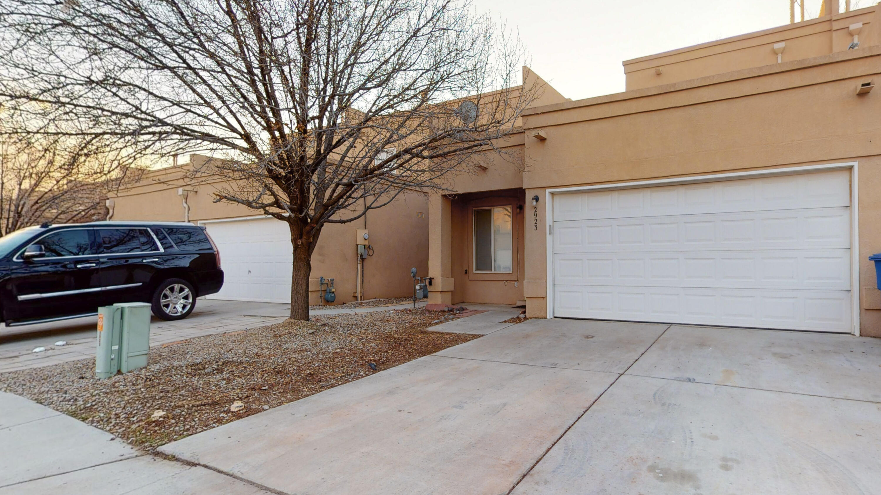 Move-in-ready townhome.  This home features 3 bedrooms and 2 full bathrooms.  The spacious owner's suite is located on the upper level with a full bath and large closet.  The other 2 bedrooms are on the lower level adjacent to the second full bath. An open kitchen with a breakfast nook with patio doors leading to the private backyard.  The backyard deck has been recently refinished.  Other recent updates and upgrades including new carpet, freshly painted, roof replaced in 2021, cooler replaced in 2020, heater and water heater replaced in 2019. Located near I-40 and Coors and close to shopping and restaurants.