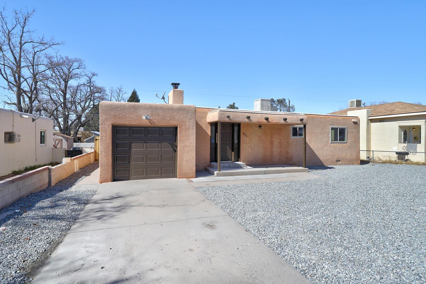 COME SEE this BEAUTIFULLY Remodeled single story home in the heart of Albuquerque!! Interior complete with DESIGNER SELECTED TWO TONE paint, PLUSH New Carpet, and a DAZZLING Lighting Package!! This home has it all and features a NEW ROOF, NEW WINDOWS, NEW FURNACE, NEW WATER HEATER, BEAUTIFULLY Updated Bathroom and the updated Kitchen features brand NEW Stainless Steel Appliances!! Great location near the Fair Grounds, UNM, NOB HILL and close to several schools, parks, and shopping centers!!  Don't Miss out on your chance to own this true Gem!! SPOTLESS AND MOVE IN READY!!