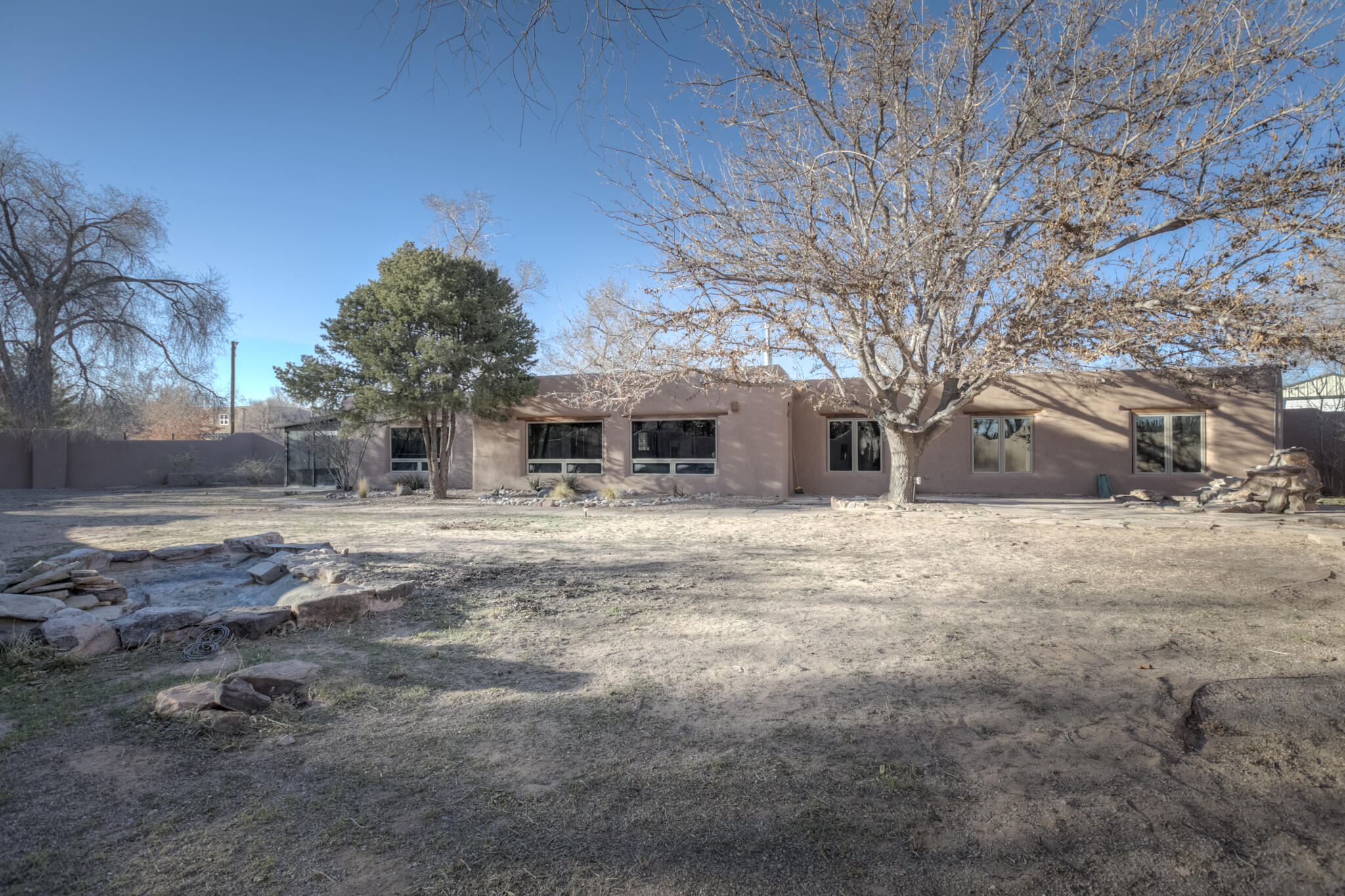 Charming Adobe home, Private Horse Property in the Corrales Greenbelt. 3 Stall Barn with Tack room, separate paddocks & pasture with access to trails and ditch irrigation. 6' adobe walled court yard. Clay wall finishes and exposed adobe. Open kitchen with granite countertops, gas Chefs stove and island. New Membrane Roof installed 1-2021, new stucco. Radiant heat and refrigerated air in the MBR and Grt Room. RV Garage with Carport.