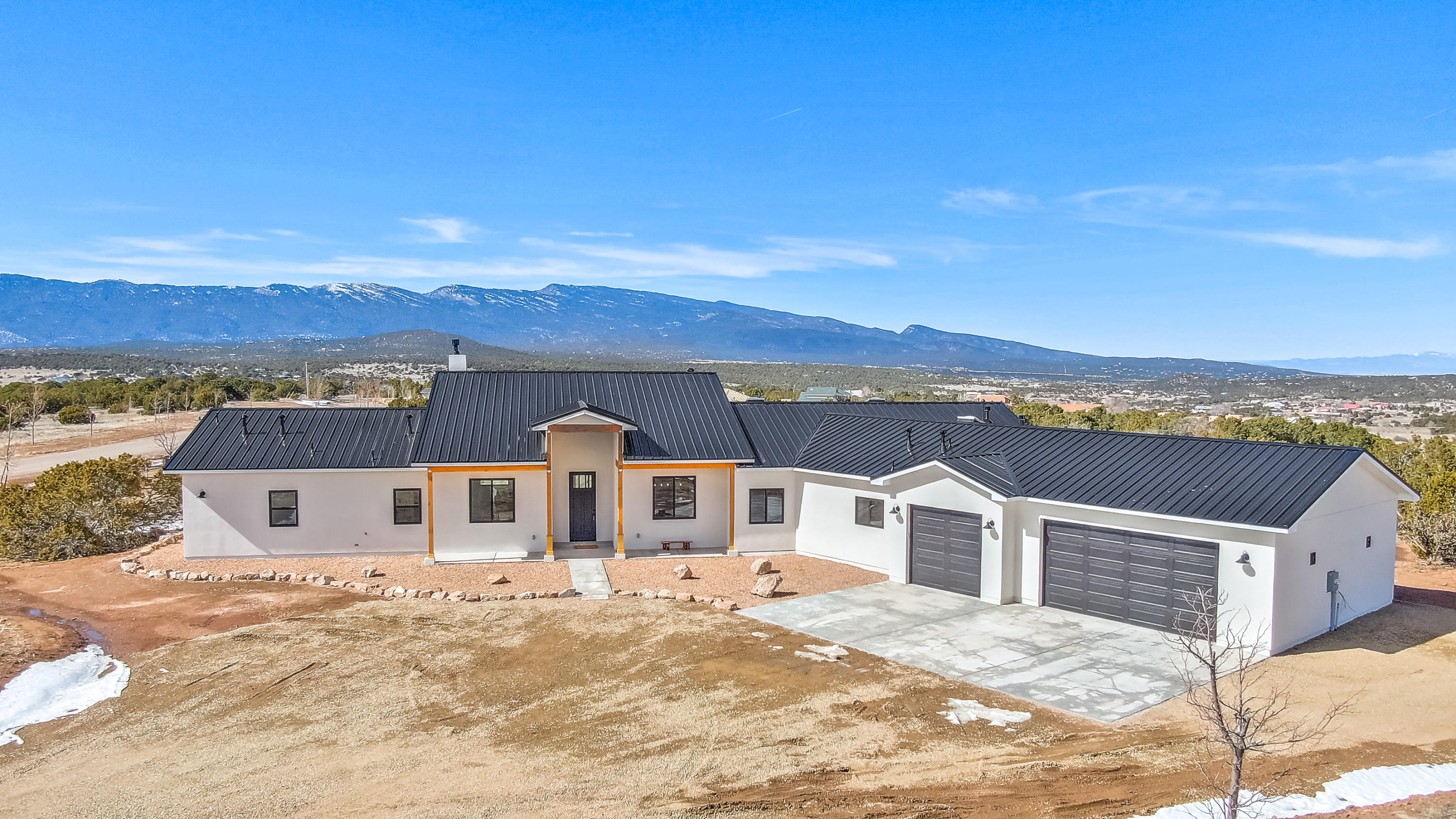 This brand new farmhouse style home is mountain living at it's finest! The panoramic mountain views are stunning along with all of the high end finishes.  There are 4 bd, 3 bth, an office, and a theatre room.  You'll enjoy the open concept with 10' ceilings, 8' solid core doors, and 9' bedroom ceilings.  The kitchen boasts stainless steel appliances, soft close cabinets, quartz counter tops, marble backsplash, pot filler, island, and walk in butler pantry.  The master has great views, coffered ceilings with accent lighting, double sinks, garden tub, walk in shower, and huge closet.  The theatre is equipped with a screen, projector, and pre-wired for speakers.  Oversized epoxy garage, tankless water heater, water softener, owned propane, great back patio and more. See feature list attached.