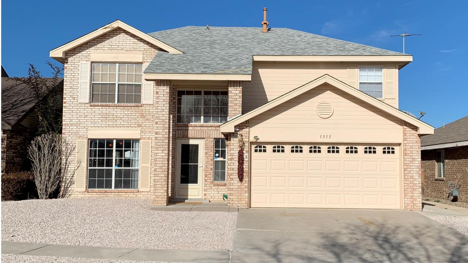 This well kept 2 story home is located near I-40 for easy freeway access. The property has great curb appeal. This home offers 3 bedrooms possible 4, 2 baths, 2 living areas, and an open concept floor plan. Granite countertop in the kitchen. Enjoy the mountain views from the deck. Backyard patio, basketball court and dog run. New roof installed in 2017. This property is priced to sell and will not last long!