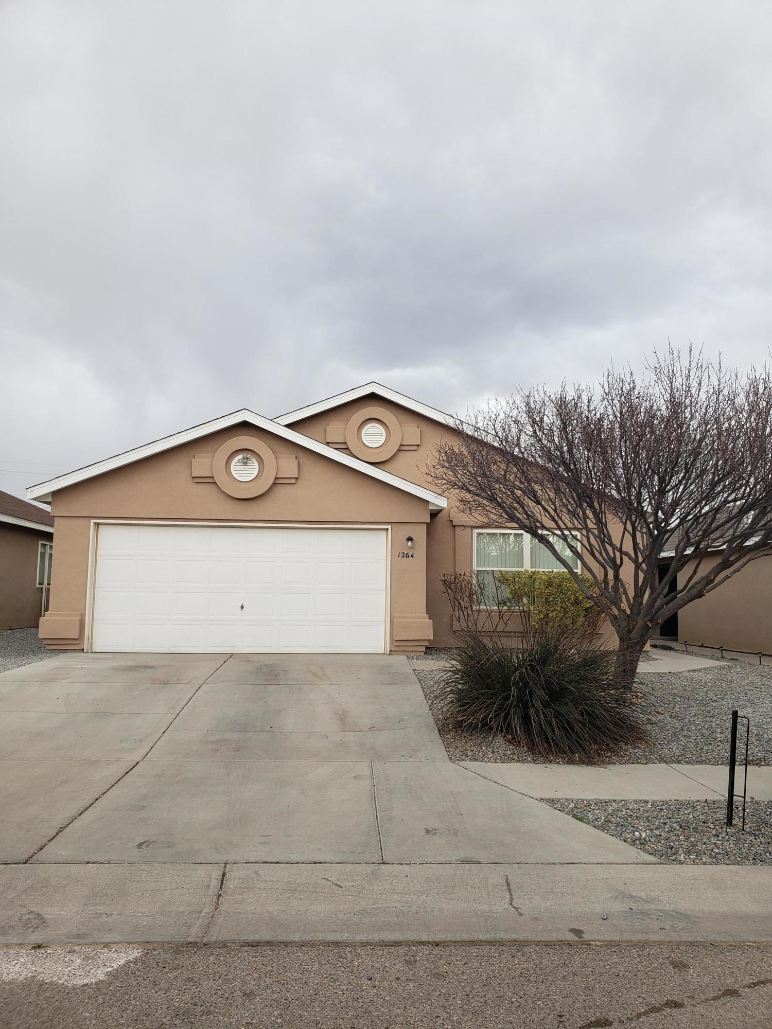 Welcome to this nice and bright well kept home in growing Southwest Heights location! This energy efficient Artistic home has vaulted ceilings, an open concept layout with nice sized bedrooms, and walk in closets. This is a very functional floorplan. Kitchen has plenty of cabinets and storage. Backyard has great views of the Sandias and City lights! No neighbors behind you/ just open space! This one will go fast! Don't miss it,  make an appointment today!