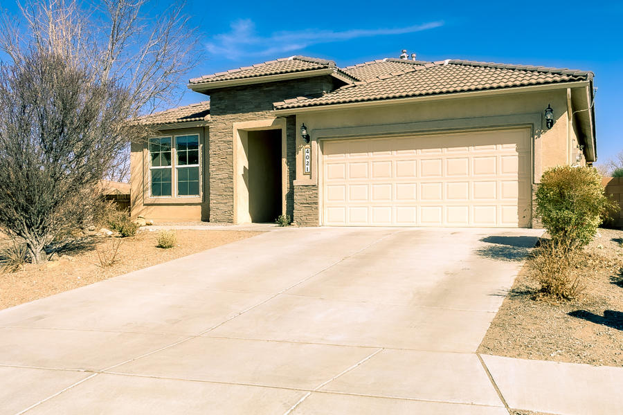 Views and open space makes  this Pulte that  sits on a premium lot a great choice.. This 4 bedroom/2 full bath home comes with all appliances. Backyard has custom covered patio to sit under for enjoying views of the Sandia Mountains. Backyard has a  firepit and raised garden beds. The solar is owned and will convey.  Home has new carpet and paint and ready for a new owner. Master is separate from other bedrooms. Refrigerated air an additional bonus.  Great location to shopping, walking to parks and school.