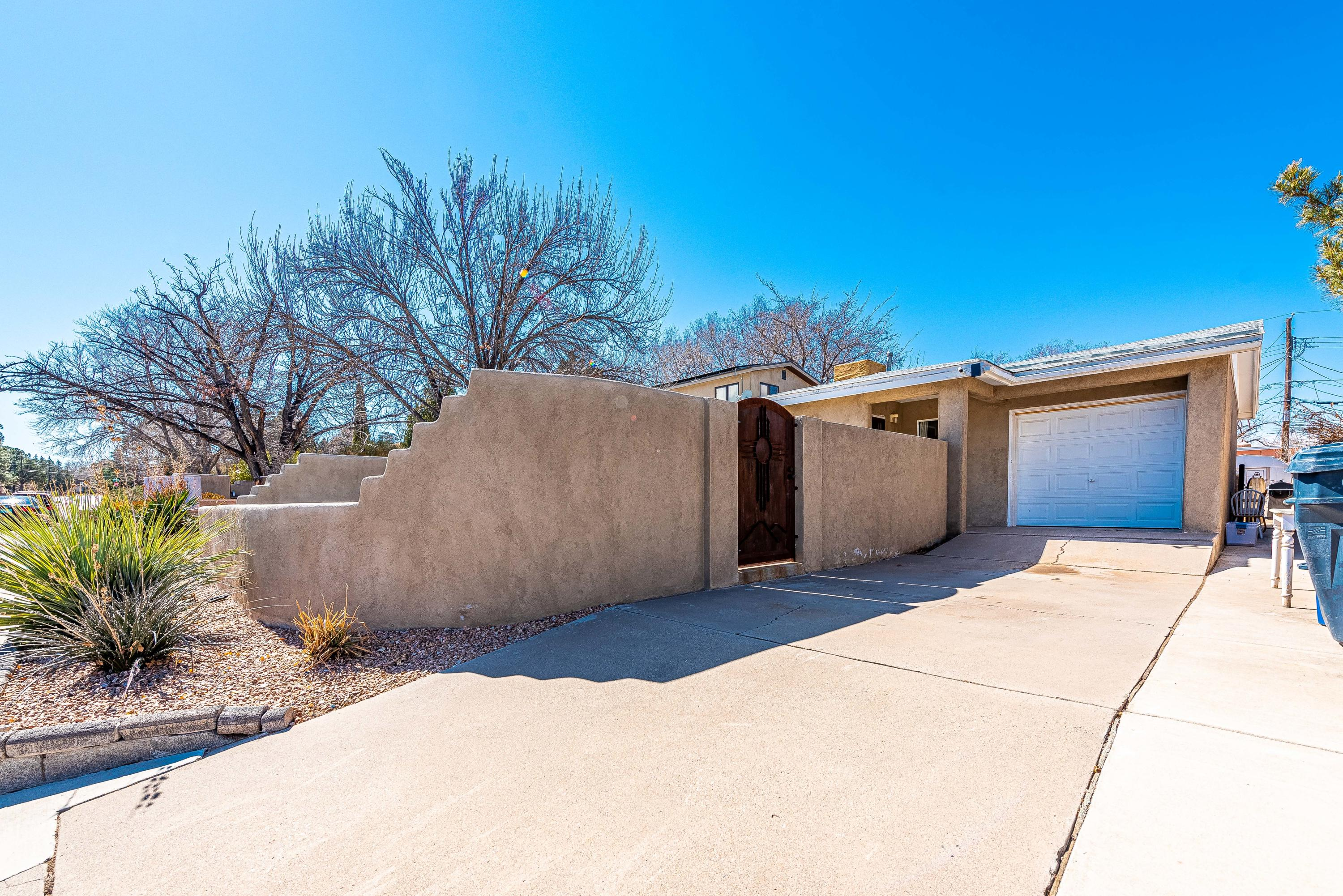 This is a 2 Bedroom home with original hardwood floors in living roman kitchen. Home offers Huge back yard, great for entertaining. Front yard offers enclosed court yard. Close to UNM.