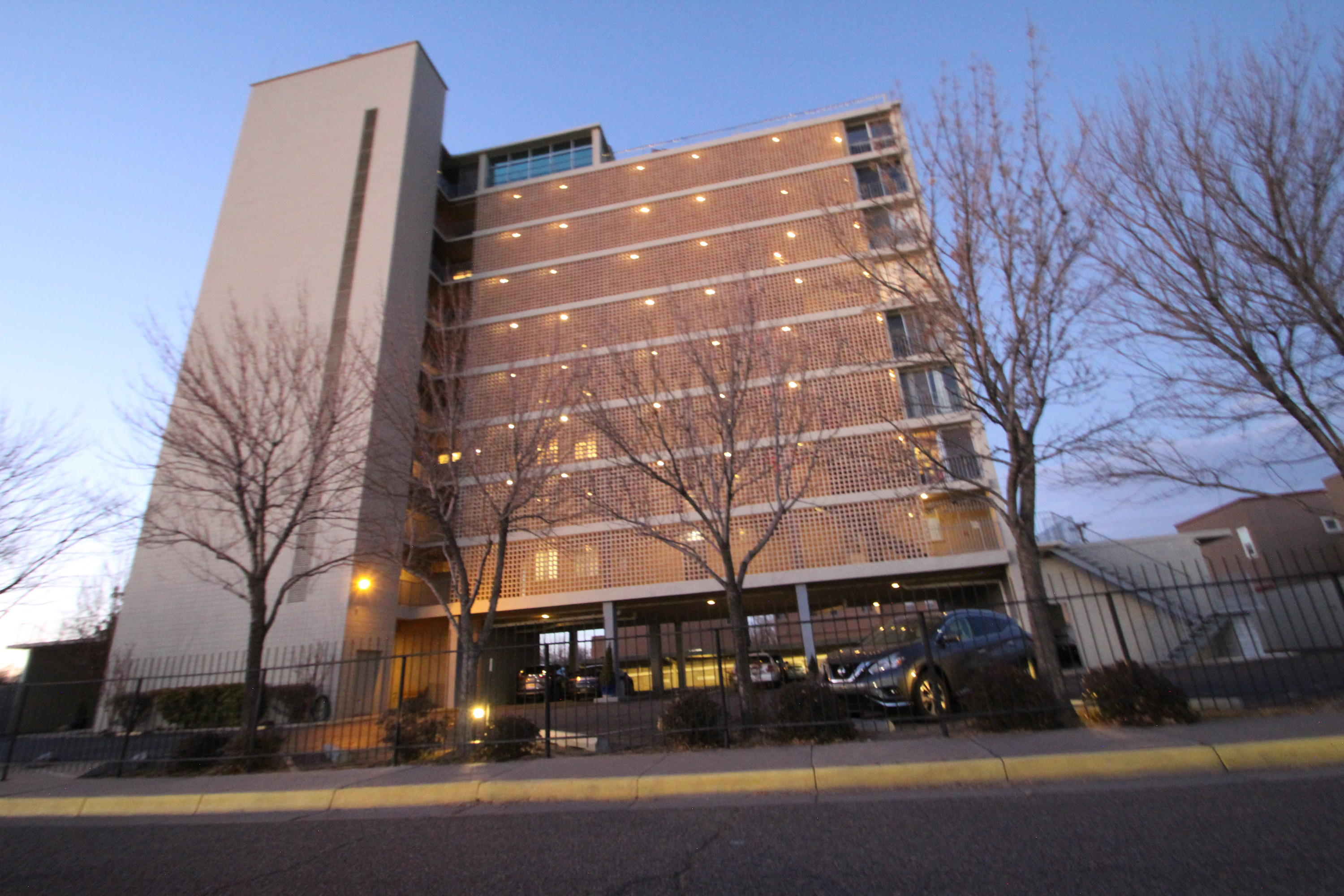 Incredible, updated knock your socks off  West Downtown Gated Condo.  Tasty kitchen with Stainless steel, Corian Counters and Custom Cabinets. Recent Furnace, Large Closets, Community Pool, large third bedroom/ office or Suite Covered indoor Room Balcony . Security entry with Covered parking . Near parks  old town dining, Two deeded parking spaces, Doorman and Elevator .