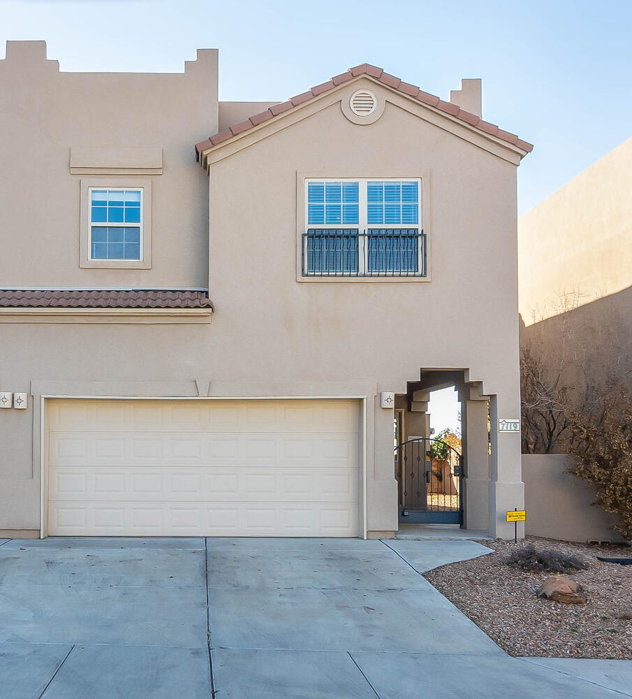 BEAUTIFUL 3 bedroom townhome, EXQUISTELY maintained! Located in a cul-de-sac & sought after Northeast heights subdivision! Private & gated courtyard entry! Lovely tile floors gracing the entire main floor. Spacious great room w/ceiling fan, opens to the expansive kitchen offering an abundance of cabinetry, tile backsplash, pantry, planning desk, recent oven & gas cook top. An atrium door opens to the patio & back yard capturing stunning sunset VIEWS & low maintenance landscaping! Large under stair storage! Generous sized master bedroom offers mountain VIEWS & full  bathroom w/garden tub, separate shower, double sinks and large walk-in closet!  2 roomy secondary bedrooms & full hall bathroom! Convenient utility closet upstairs! RECENT water heater, 2017 ! Refrig. air! 2 car garage w/opener!