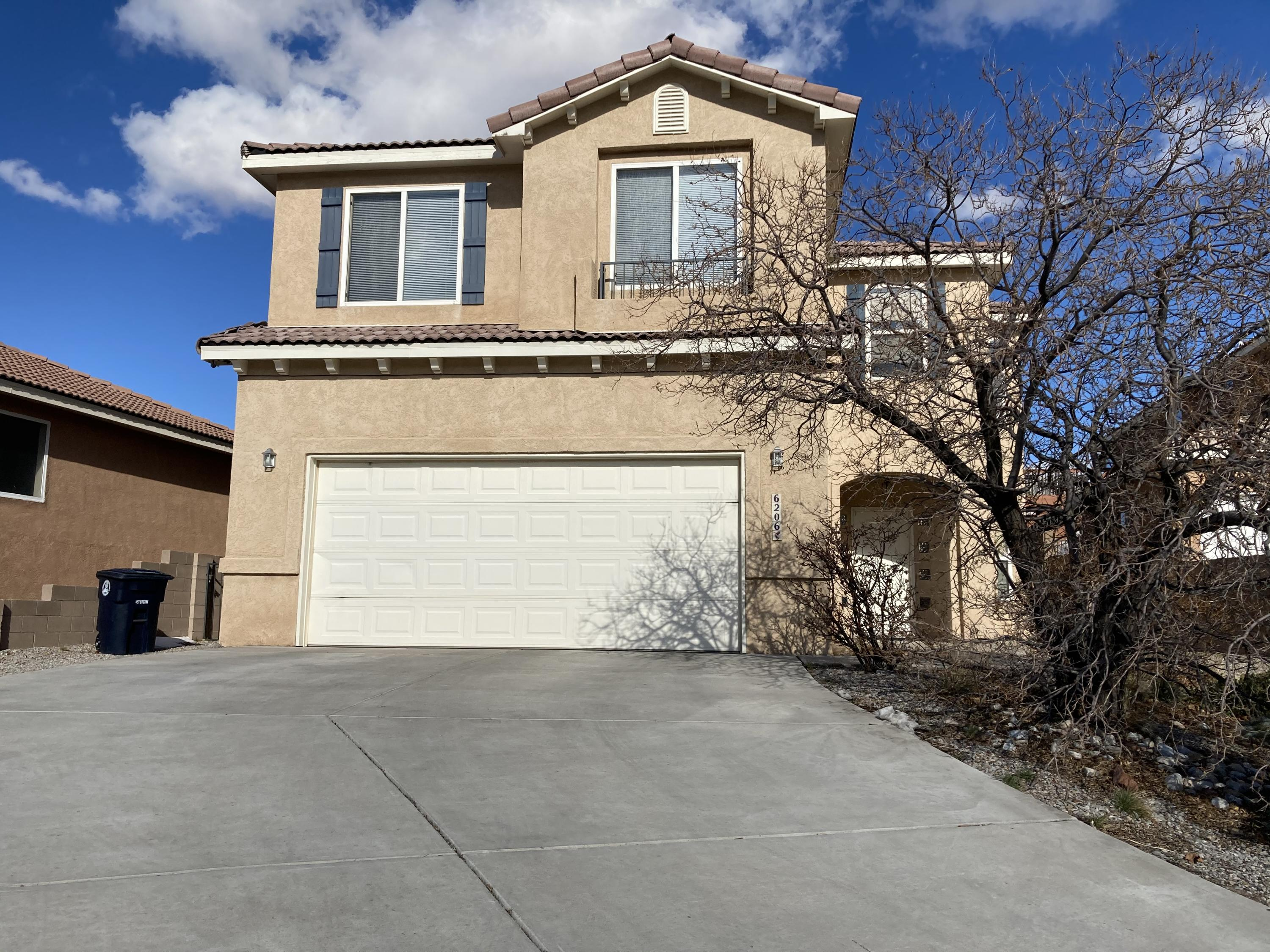 Large home with 4 big bedrooms and loft. 2 way fireplace between family room and dining room, separate living room. Cathedral ceilings. Balcony with views off primary bedroom!