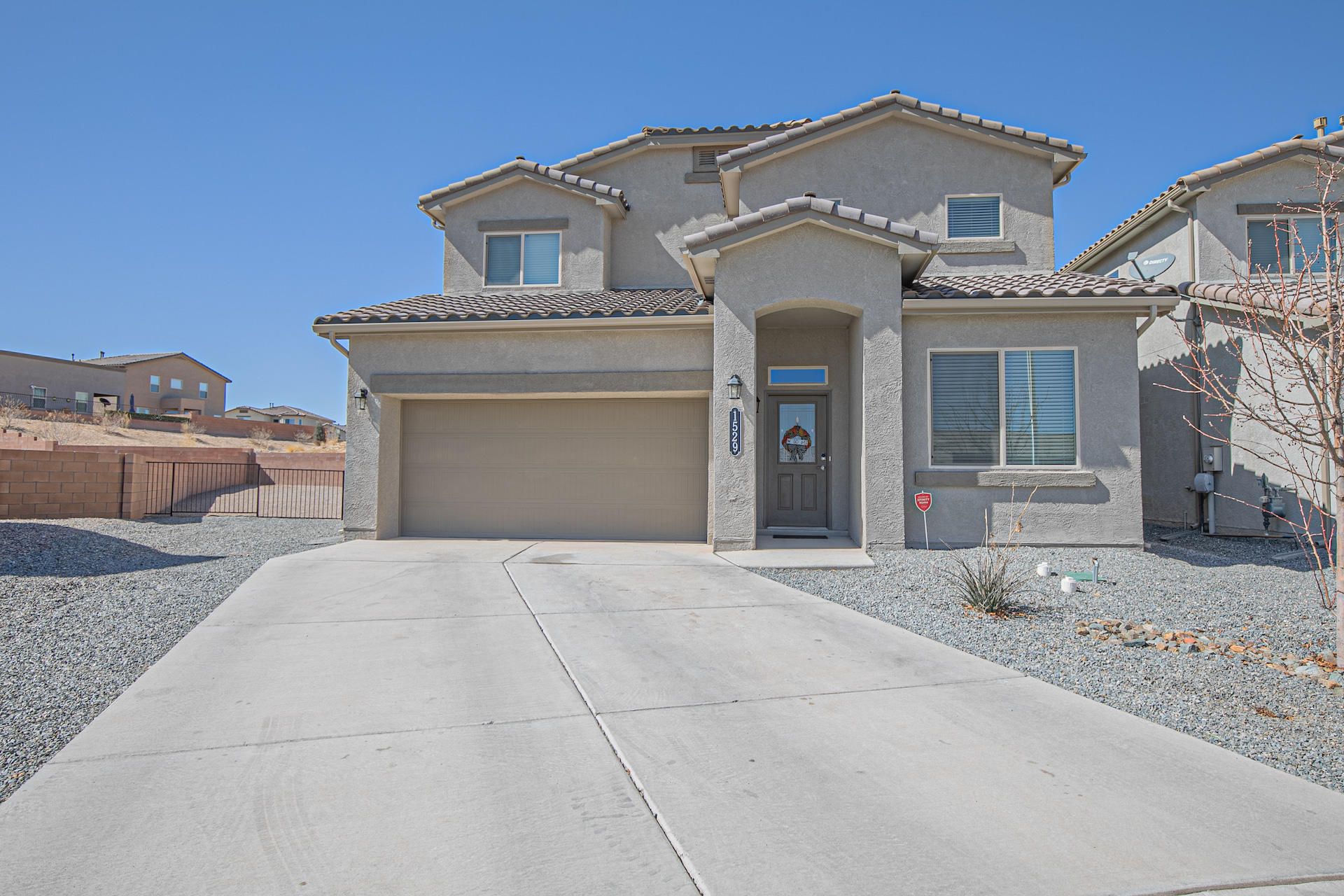 Beautiful, immaculate home on a quiet cul-de-sac near Los Lunas High School, close to shopping and restaurants. You won't be disappointed when you see this 4 bedroom 4 bath home. This home welcomes you with beautiful tile floors, granite counter tops and stainless steel appliances. The open floor plan is perfect for entertaining. Now that it's getting warmer, take your guests out on the covered patio and enjoy the firepit in the evenings. Master bedroom is on the main floor with a second master upstairs along with 2 other bedrooms, full bath and the second living area in the loft.  Large xeriscape yard is completely fenced with back yard access. There are walking trails all around this highly sought after area. Make your appointment today.