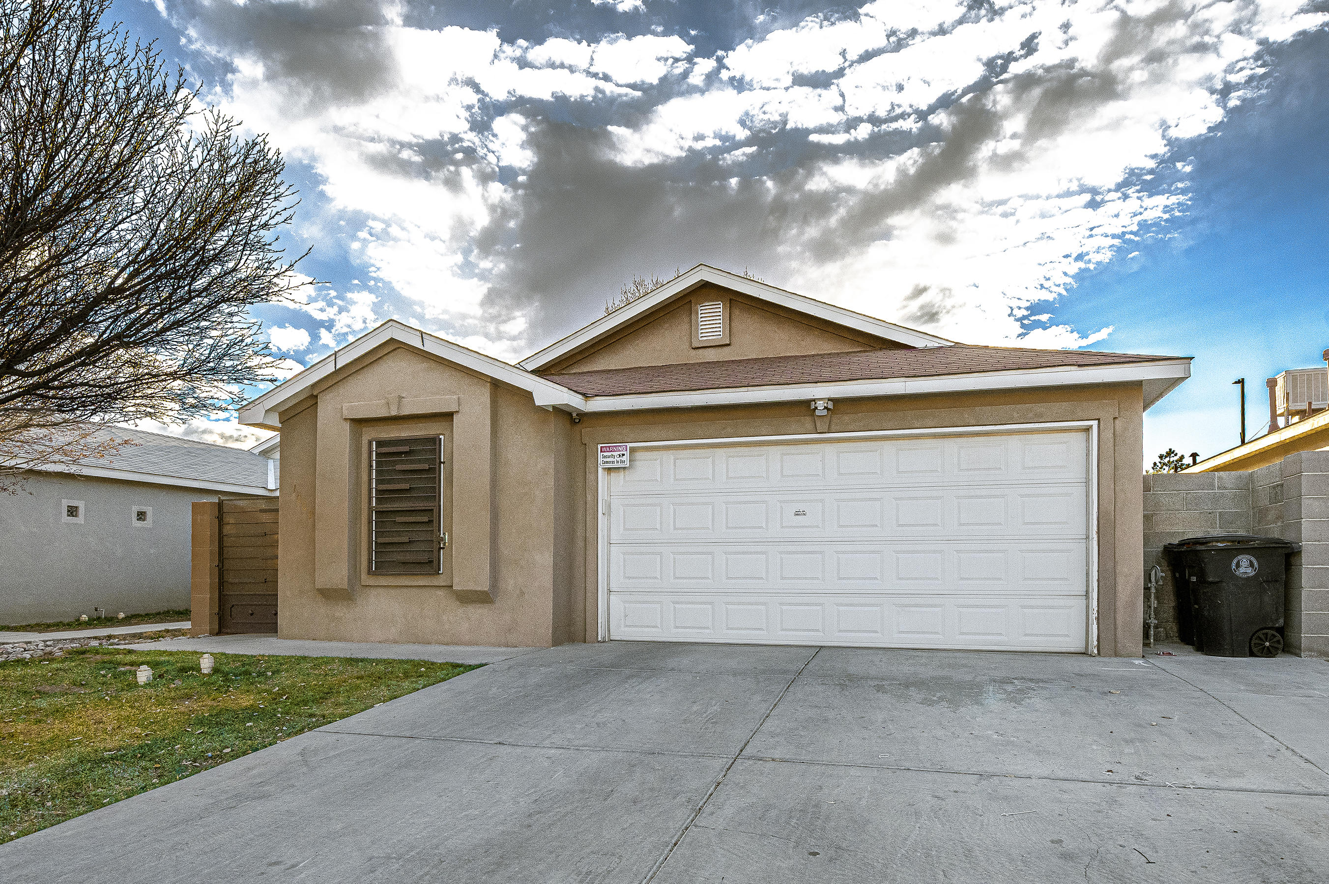 Move in ready!! Updated  and well maintained 4 Bedroom home, 2 full baths! Conveniently located near I-40 and Coors Blvd. Home features nice open floor plan, tile floors, updated kitchen cabinets with quartz countertop, sprinkler system in front yard,  video security system. Don't miss this one!