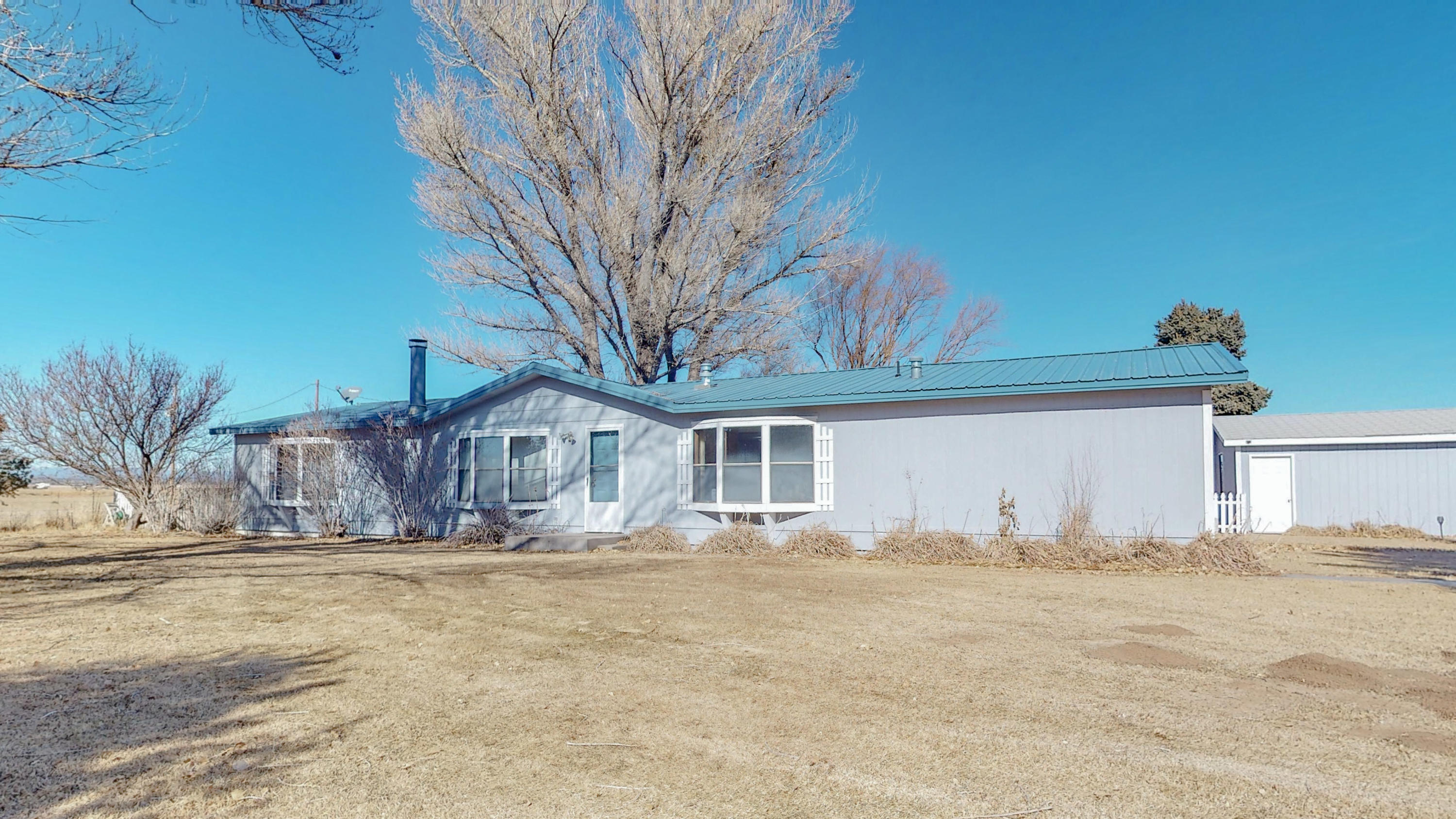 Live, work, play and be safe. Beautiful 35 acres with gorgeous views and a very nice doublewide. Please see virtual tour and pictures. There is a horse barn, work shop and small office building that needs repairs.Domestic well on the property.Frontage on Hwy  41 zoned commercial.