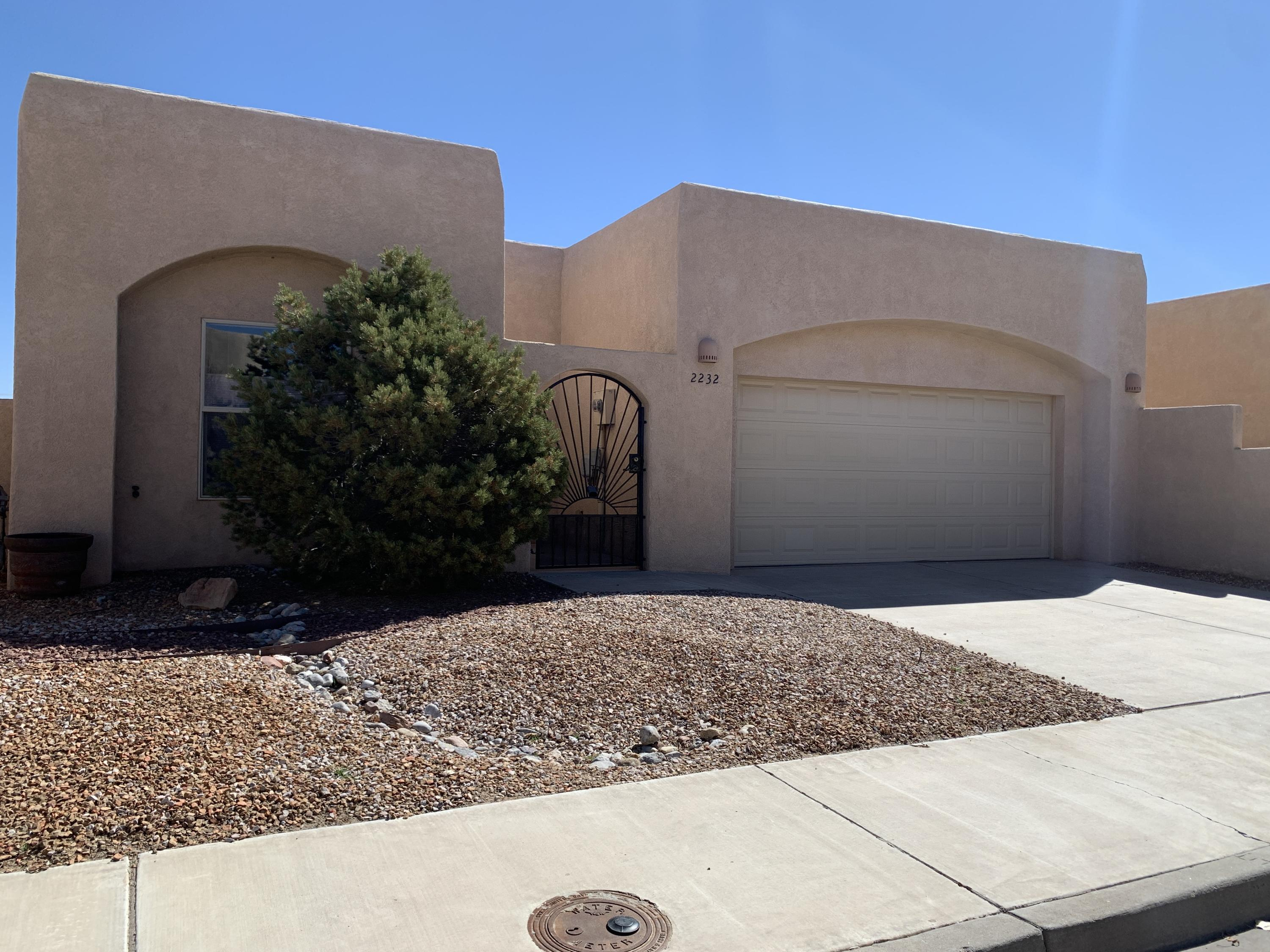 Well cared for lovely home in gated community near I-25 in Los Lunas. Single Story, custom pueblo sports 3 bedrooms, two full baths, spacious kitchen and living areas with high ceilings and covered patio. Skylights in both the kitchen and the master closet add light throughout! Recent updates include Safe Step walk-in jetted tub in the owner's suite, refrigerated air and heat unit installed in 2019, new roof installed 2016, and 50 gallon water heater installed 2020! Enjoy the wonderfully private rear yard.  Home is move in ready!