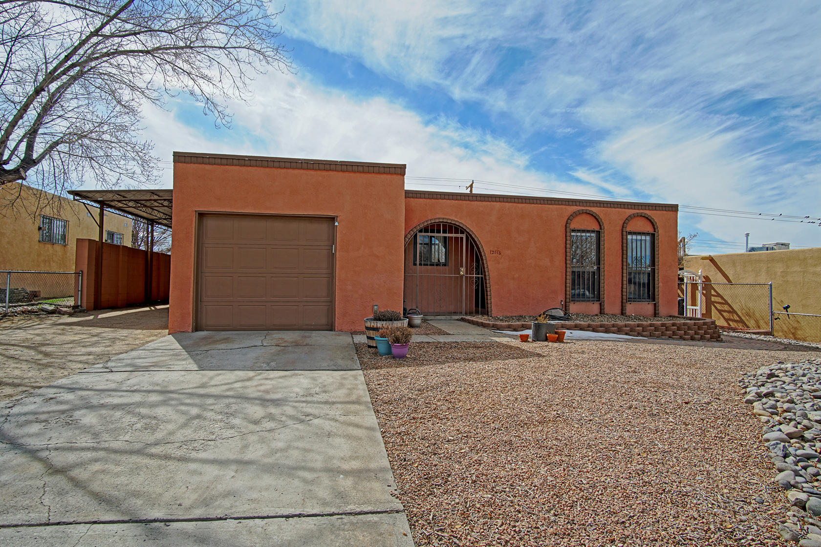 Move in ready! Price Reduced! Spacious home in the NE Heights and Eldorado school district. Updates include newer ceramic tile, vinyl plank flooring, and one-year old master cool. Solar panels are only 3 years old and the sellers are willing to pay them off for you. Featuring large kitchen with oak cabinets, and all appliances will stay. Ceiling fans throughout the home. Do you like to entertain? Bring the pool table or arcade games! Family/game room can hold it all and would be a perfect place to hang out. It also has its own evaporated air conditioner and new thermostat. Outside you will find storage shed in the walled backyard, a 60 ft. metal carport for covered parking, in addition to the single car garage. Did I mention, it has a TPO roof. Right around the corner are school and shops.