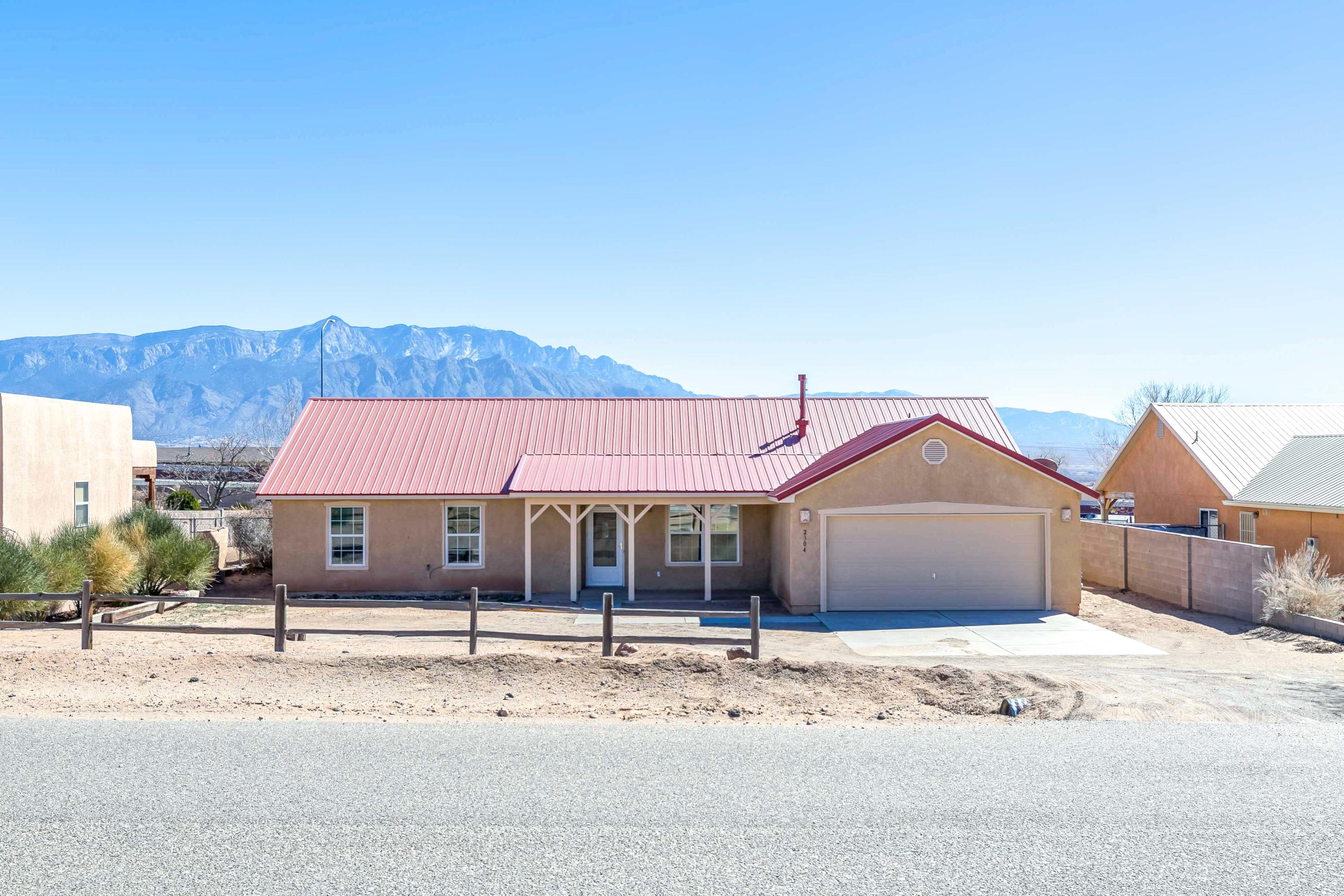 Cozy three bed, two bath, with mountain views.  This open floor plan features lots of natural light, intricate detail, and a cathedral ceiling.  New flooring and fresh paint throughout.  This home is a must see!