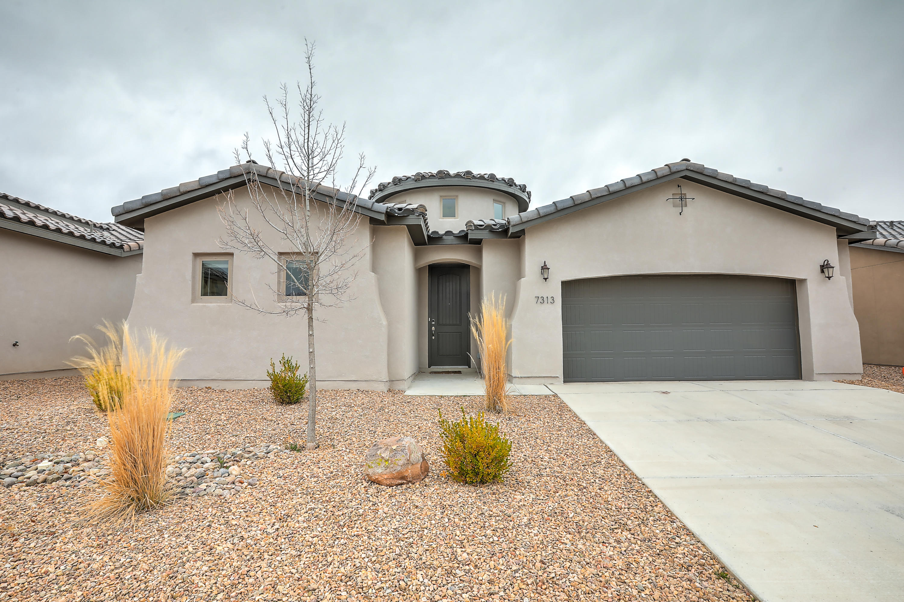 Newer Abrazo home with over $30,000 in upgrades. One story three bedrooms plus an office, two full bathrooms plus a guest bath. Gas fireplace, granite countertops, stainless steel appliances. Fridge, washer, and dryer convey with the purchase. Very convenient location close to Whole Foods, Albuquerque Academy, restaurants, parks, and easy access to I25 yet quiet and classy neighborhood.
