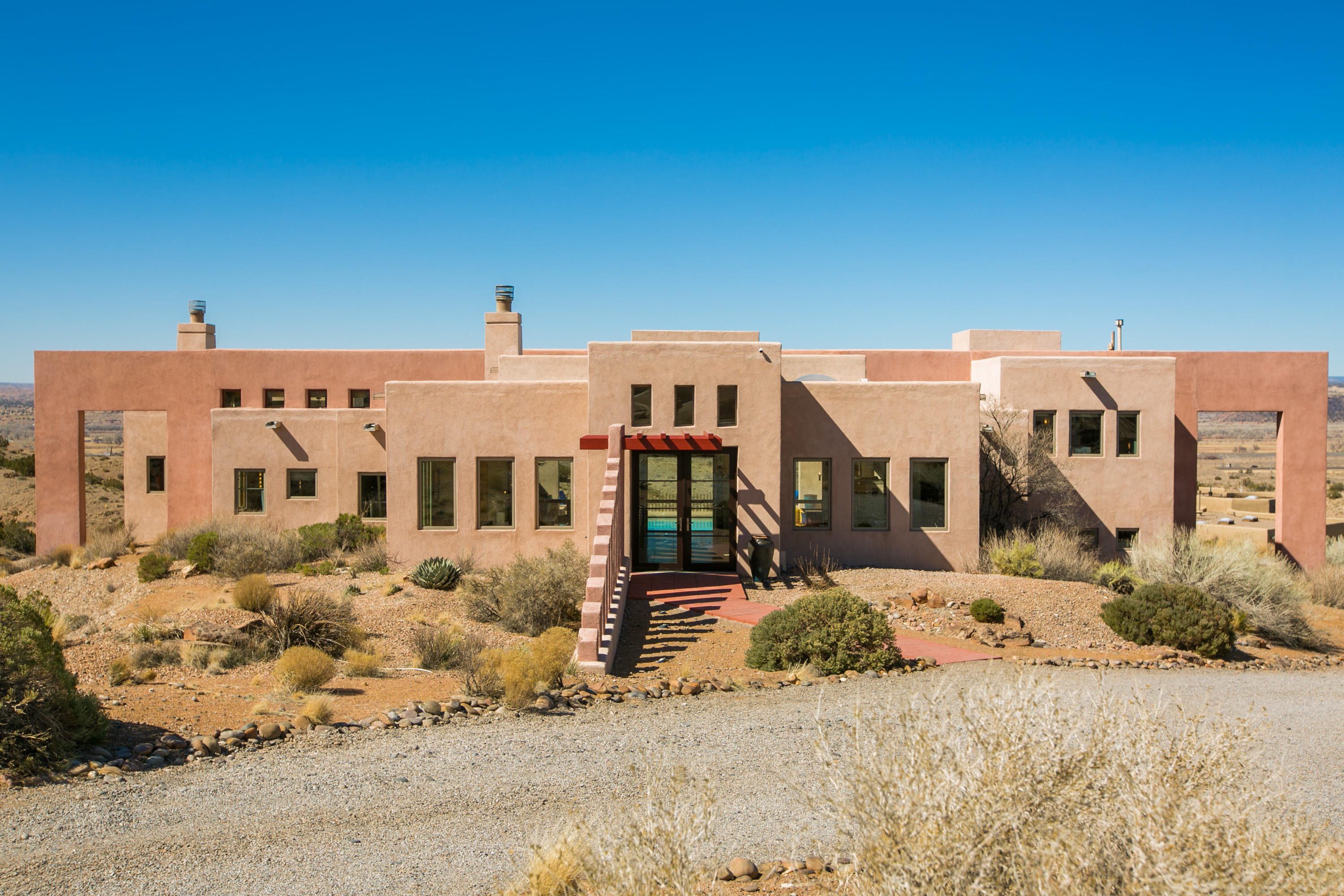 This beautiful contemporary Southwest home was thoughtfully placed upon a 2-acre cul-de-sac lot to showcase the stunning 360 views of the Sandia and Jemez mountain ranges, as well as the breathtaking sunsets, city lights and western mesas. Designed by architect Brian DePriest of Sydroya Designs, this home marries design and technology to create an ''efficient and attractive use of space.''  The great room, two master suites, both with en-suite baths & walk in closets, guest bedroom, office & media room offer flexibility & abundant living and/or remote working spaces. Luxury amenities include: travertine tile; aspen clad ceilings & vigas in the great room, den & entry; wood-clad windows; 5 sliding glass doors; chef's kitchen w/ eucalyptus cabinetry, *Click More for additional info