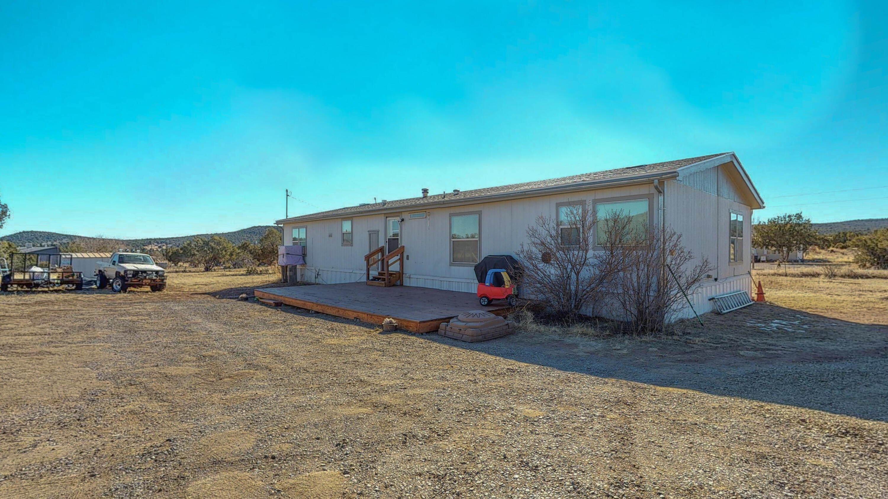Peace and quiet with GORGEOUS views!! 4 bedrooms and 2 bathrooms on 1.75 acres...perfect family starter home!  Room for the kids to play and everyone's toys. Ready for your updates, garden, or animals.
